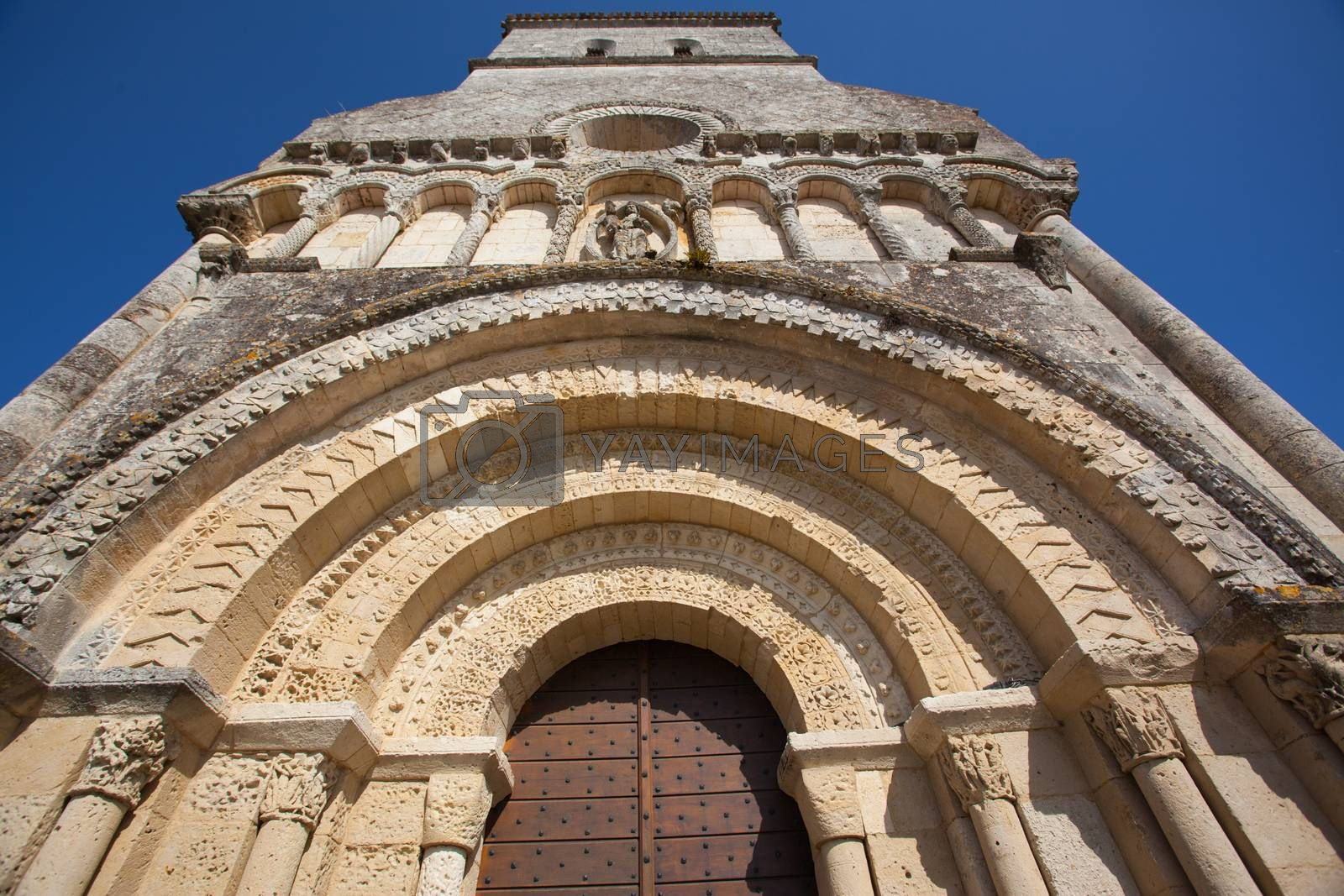 Main entrance archivolts detail of the Rioux church .Region of Charente in France
