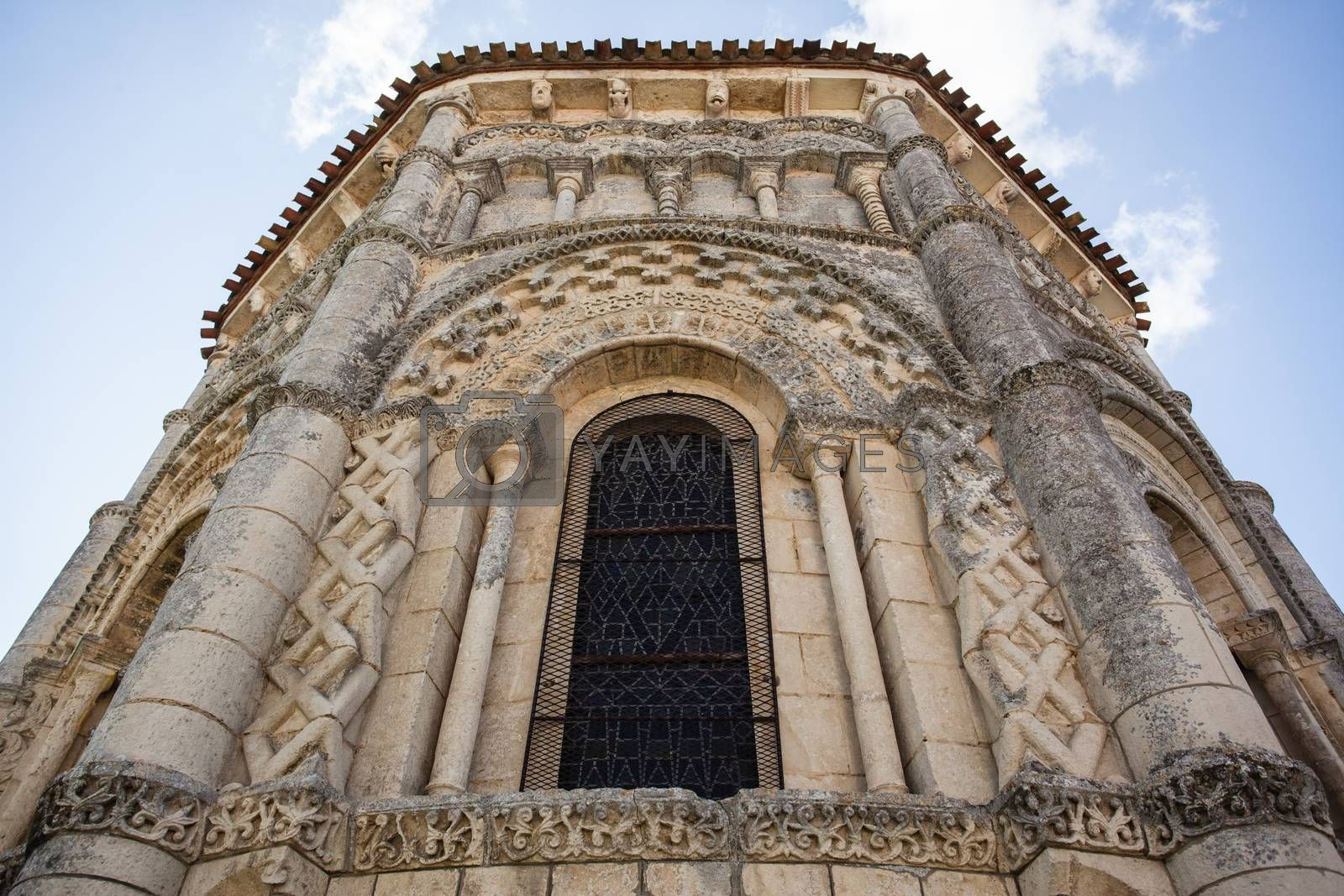 Abse window of the romanesque Rioux church. Region of Charente in France