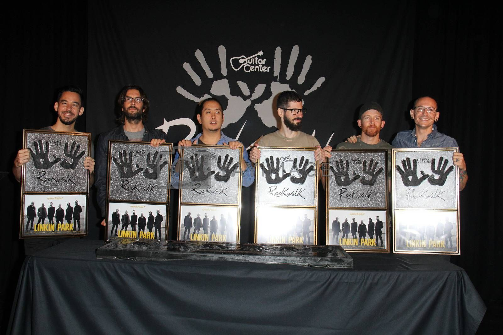 Royalty free image of Linkin Park, Mike Shinoda, Rob Bourdon, Joe Hahn, Brad Delson, Dave Farrell, Chester Bennington at the ceremony inducting Linkin Park into the Guitar Center's Rockwalk, Guitar Center, Los Angeles, CA 06-18-14/ImageCollect by ImageCollect