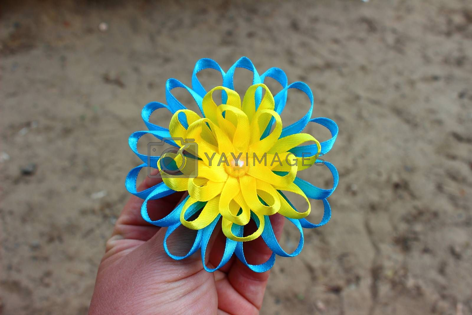 flower of yellow and blue ribbons with bead handmade