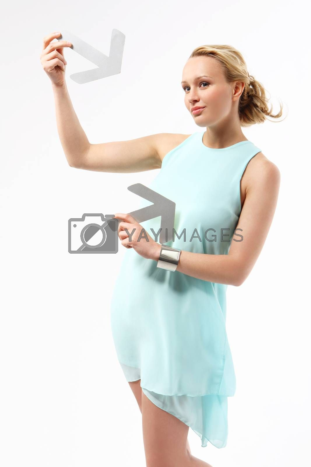 Elegant young woman pointing with silver arrows.