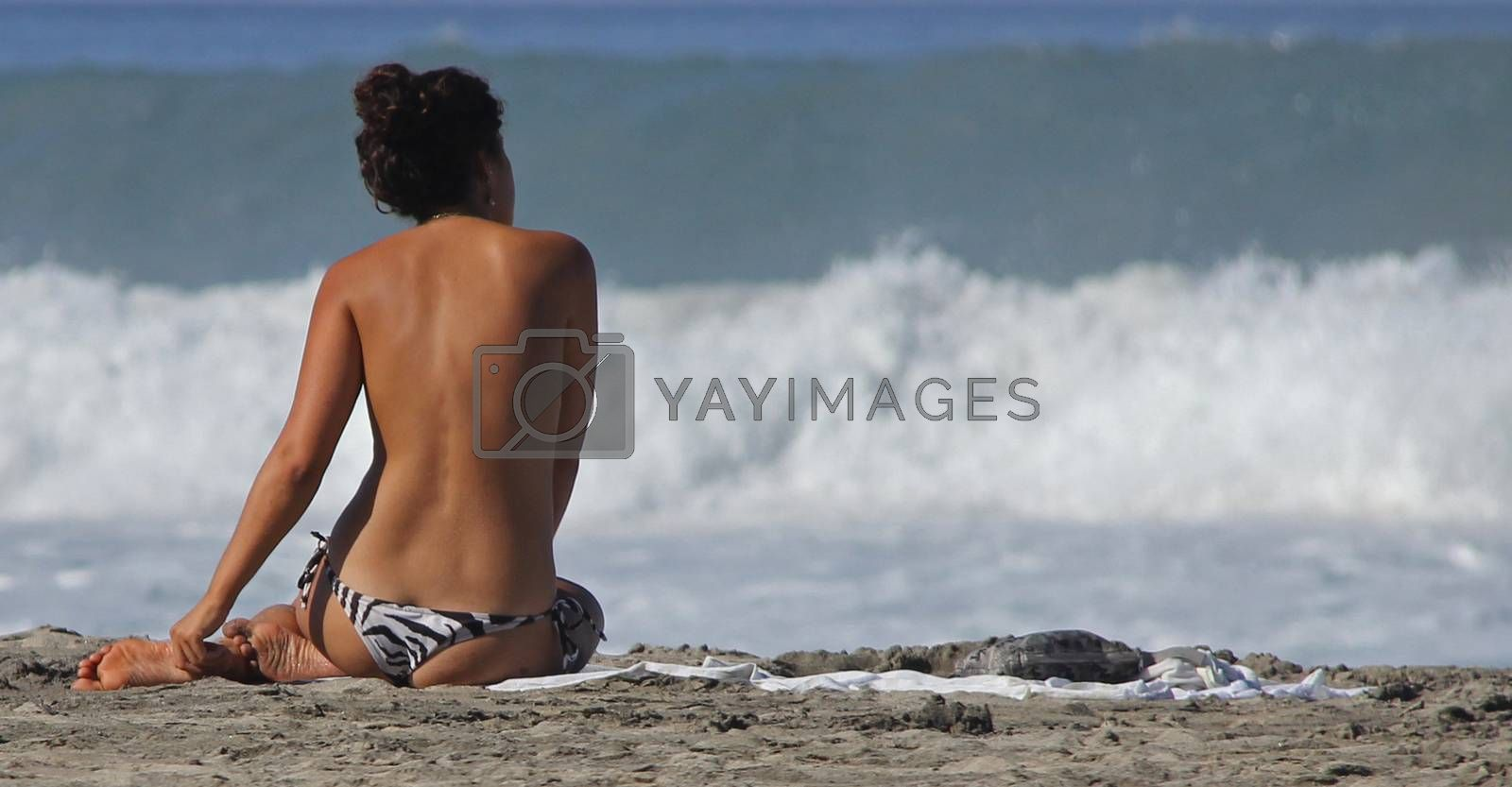 A young topless woman on a beach in Puerto Escondido, Mexico 24 Mar 2013 No model release Editorial only
