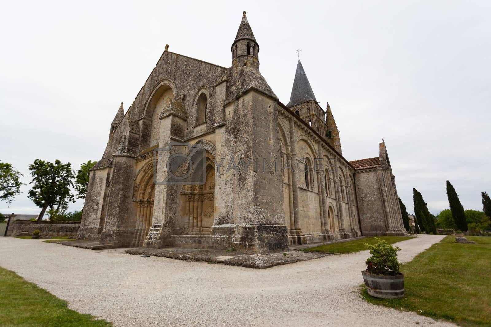 Full side  view of Aulnay de Saintonge church in Charente Maritime region of France