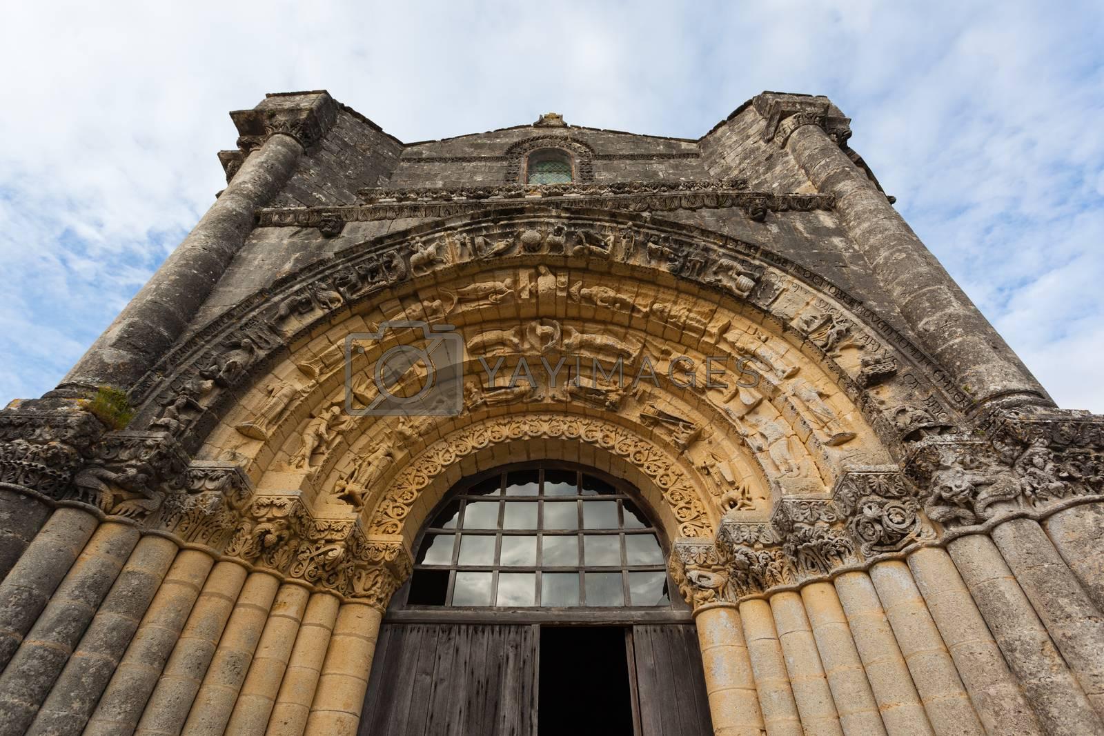 West facade archivolts of Notre-Dame de l'Assomption de Fenioux church in Charente Maritime region of France
