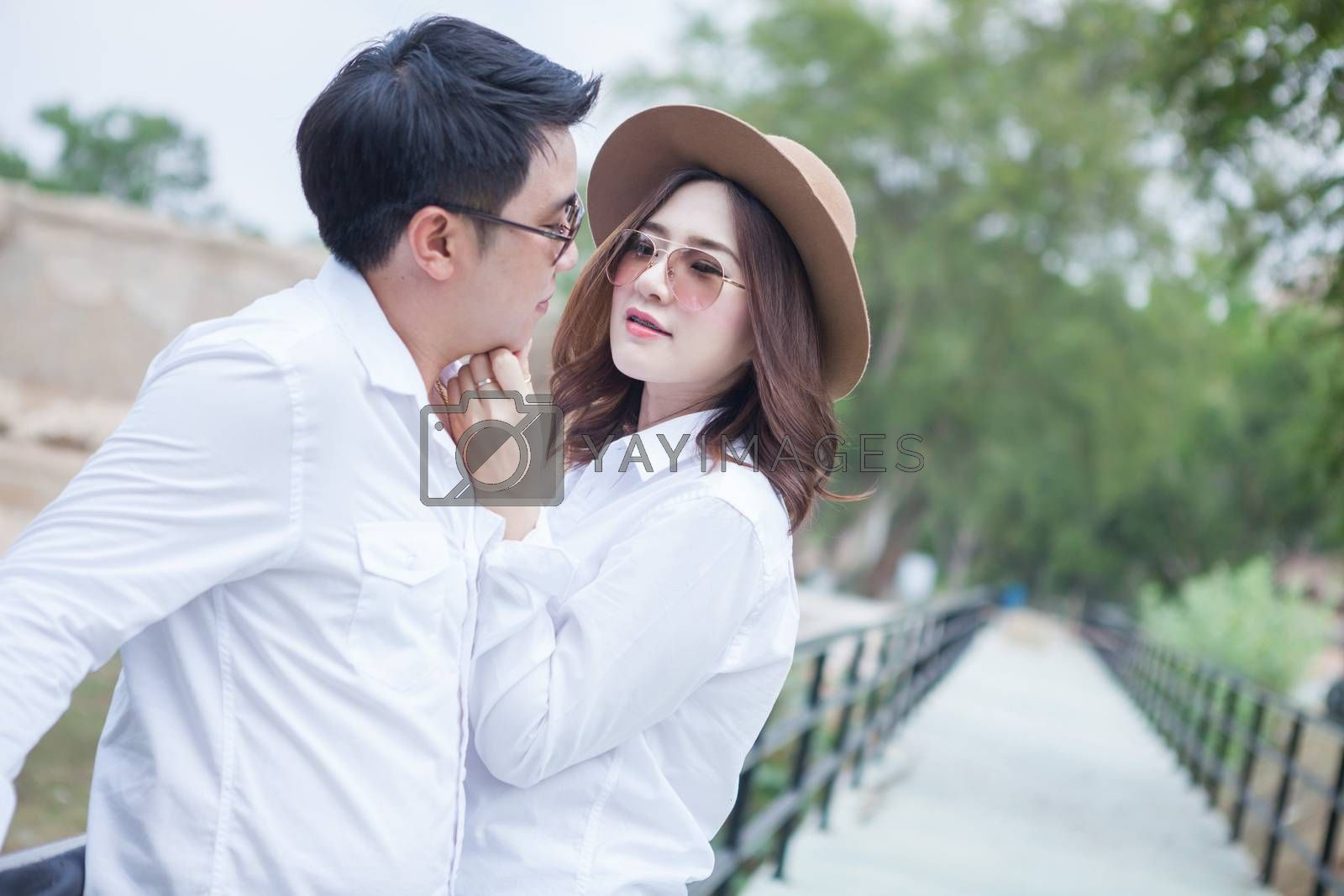 Happy young asian couple in love outdoor