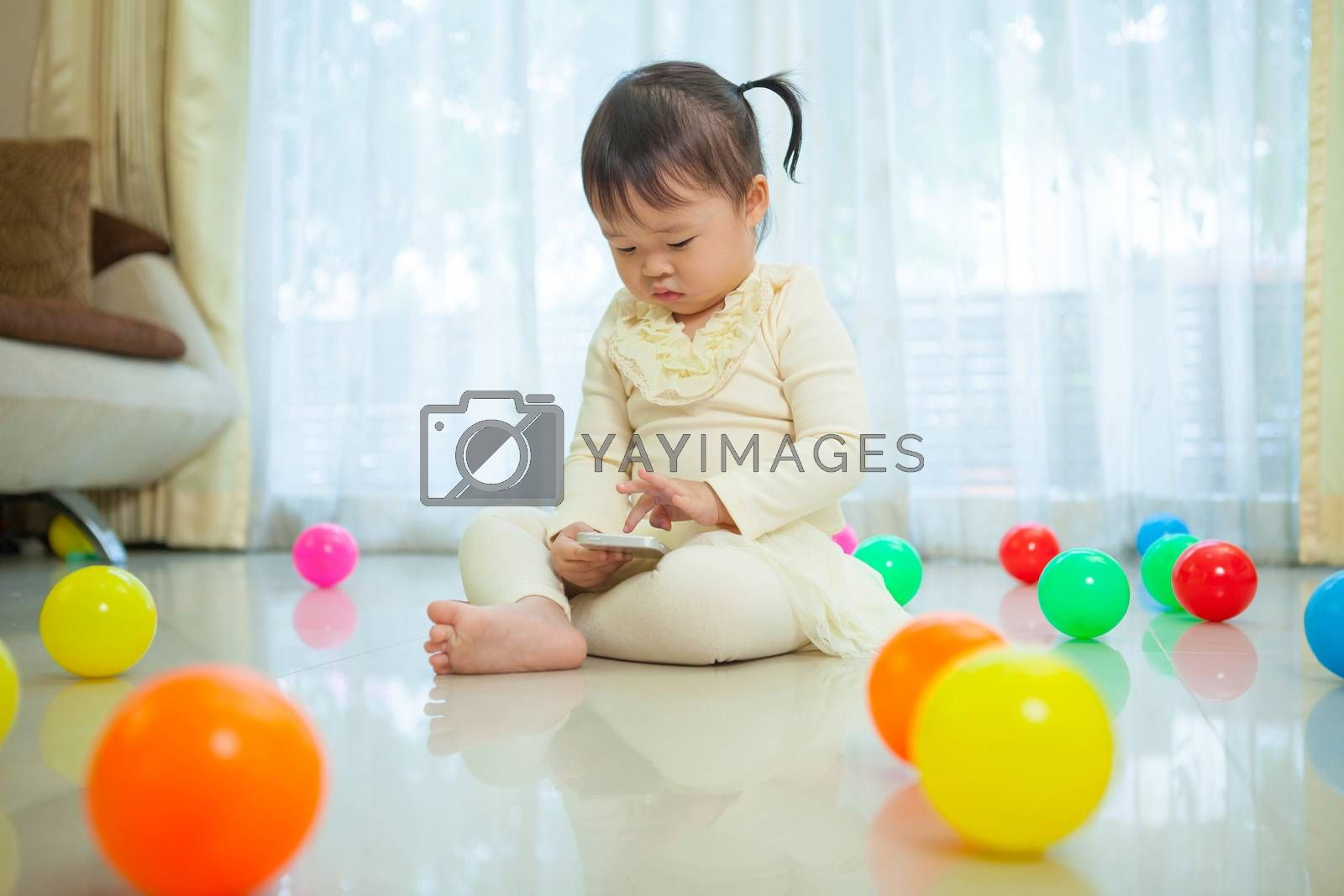 little girl using mobile phone by witthaya