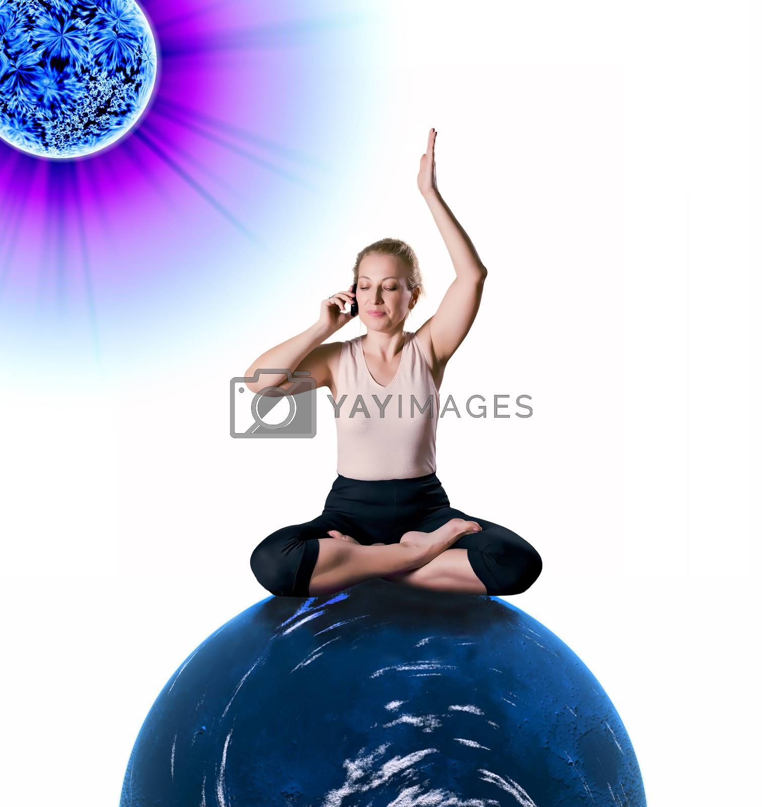 Woman sitting in lotus position on the blue planet, is holding the phone and listening