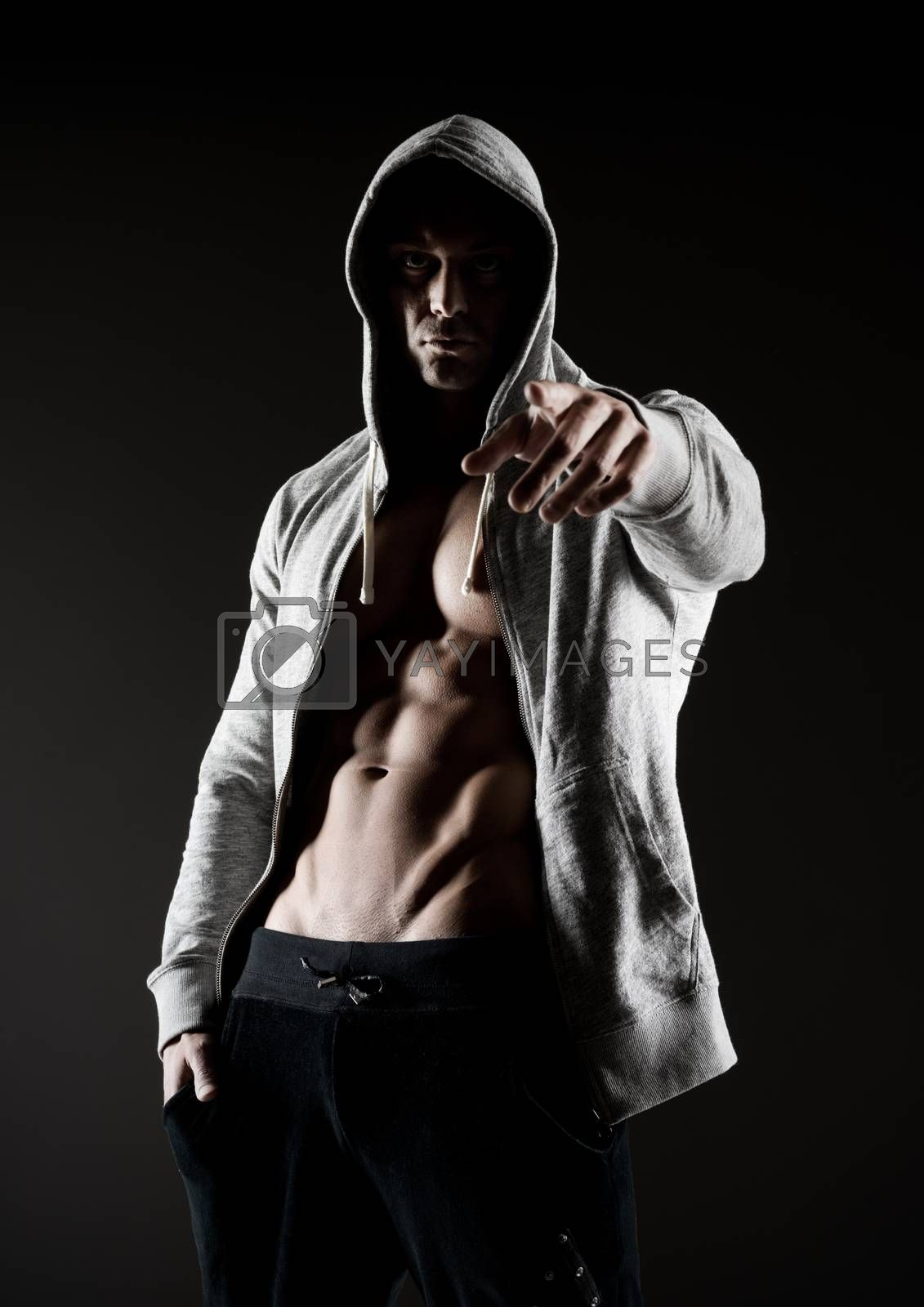 Confident body builder in hooded shirt with bare chest.