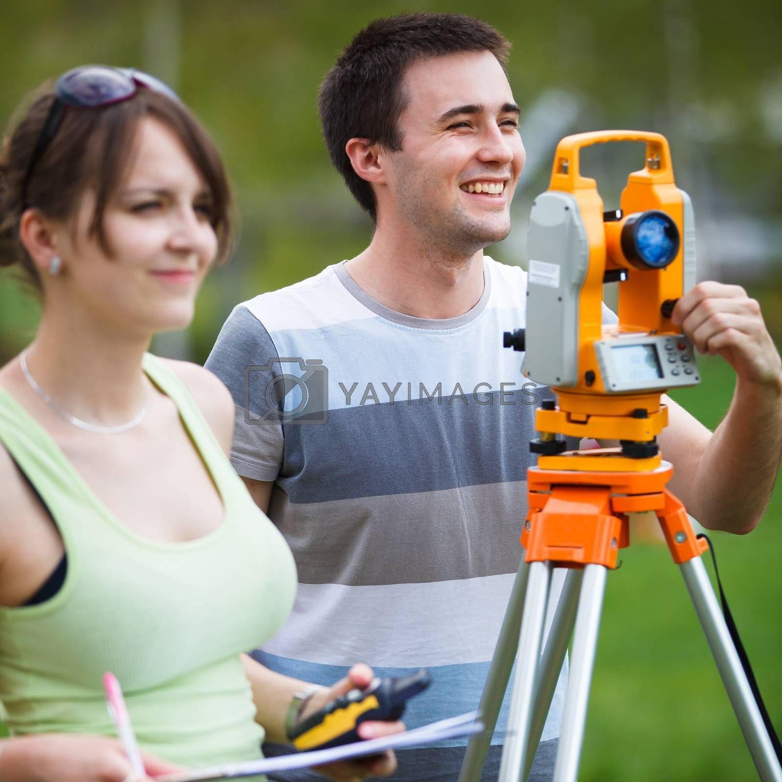 Two young land surveyors at work by Viktor Cap