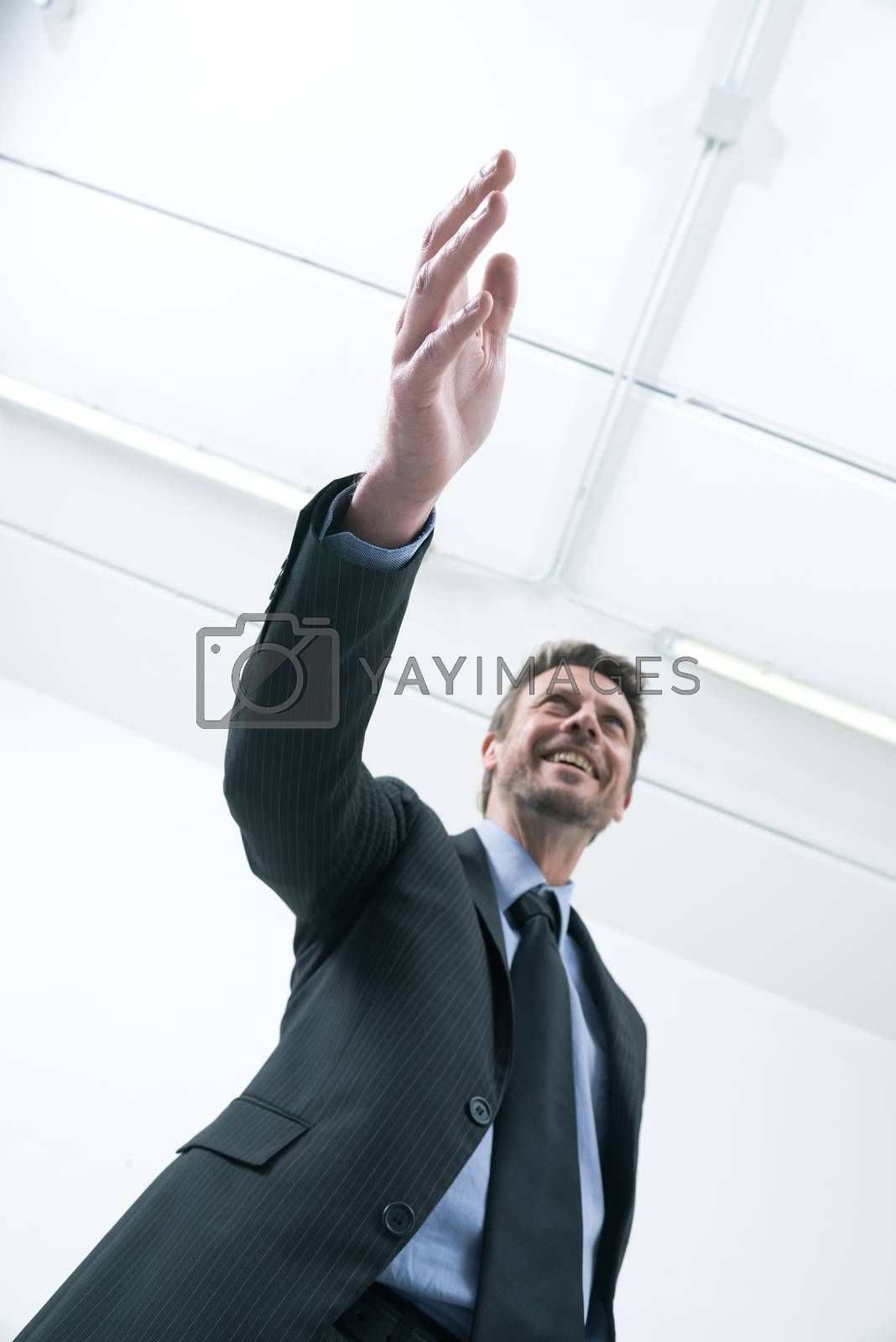 Confident smiling businessman giving an handshake bottom view.