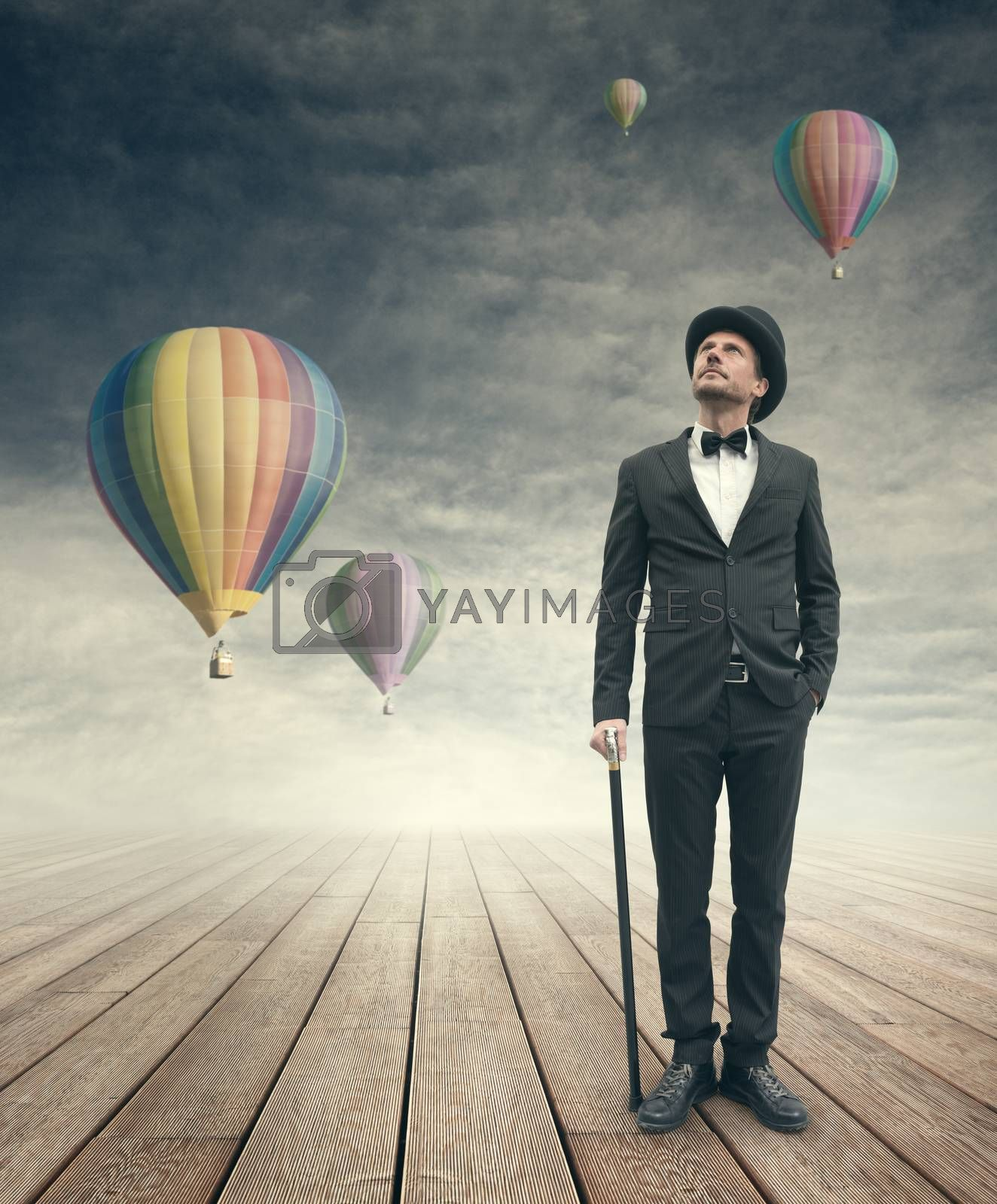 Imaginative vintage businessman with hot air ballons by stokkete