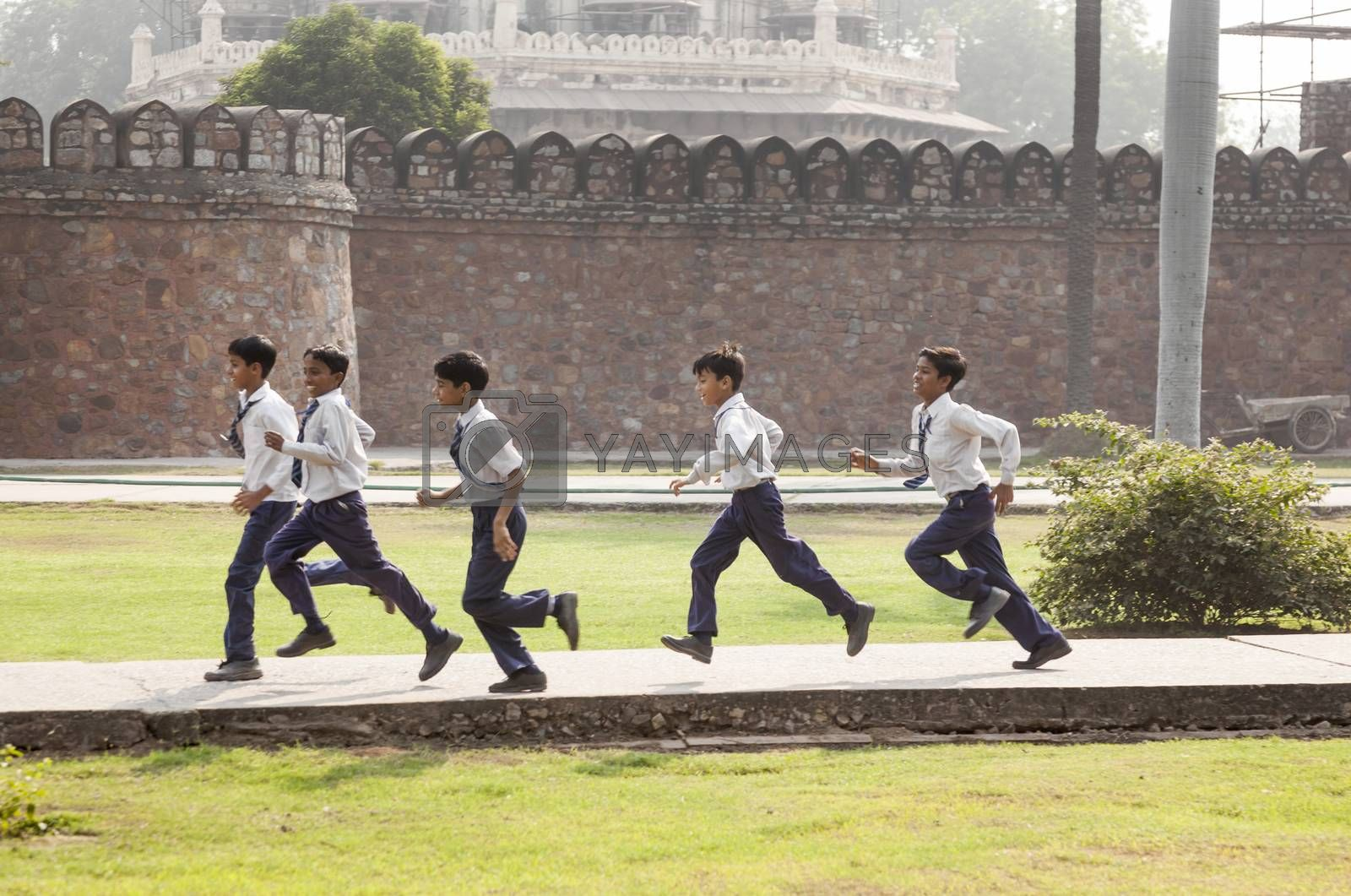 DELHI, INDIA NOV 11, 2011: school class visits Humayuns tomb in Delhi, India. The boys in school uniform have fun posing for a foto. Schools visit the famous landmarks as part of national education.