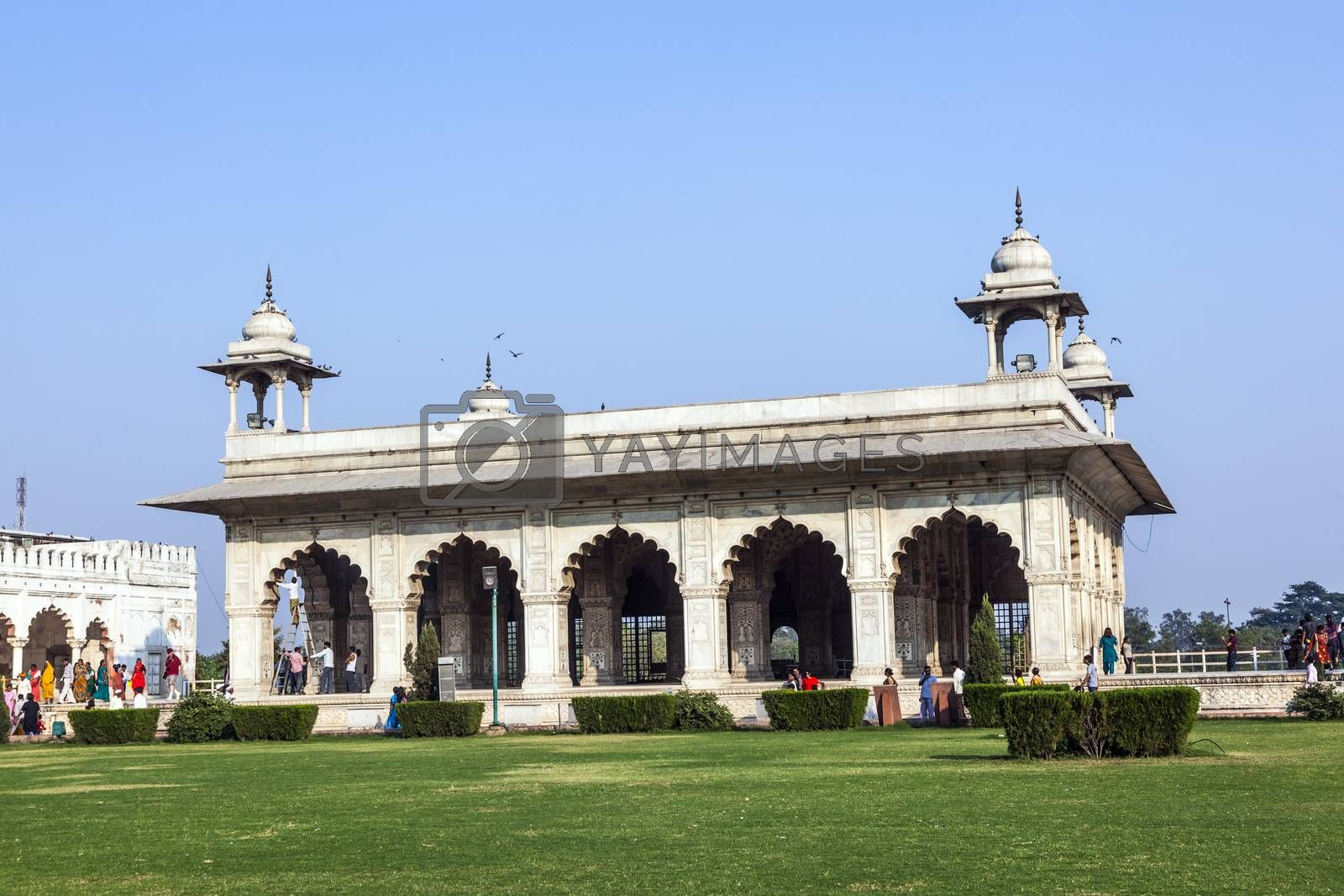 DELHI, INDIA - NOV 11, 2011: Local people spend their leisure time in the afternoon, before the Diwan-i-Khas, the white building in Red Fort, Delhi, India.