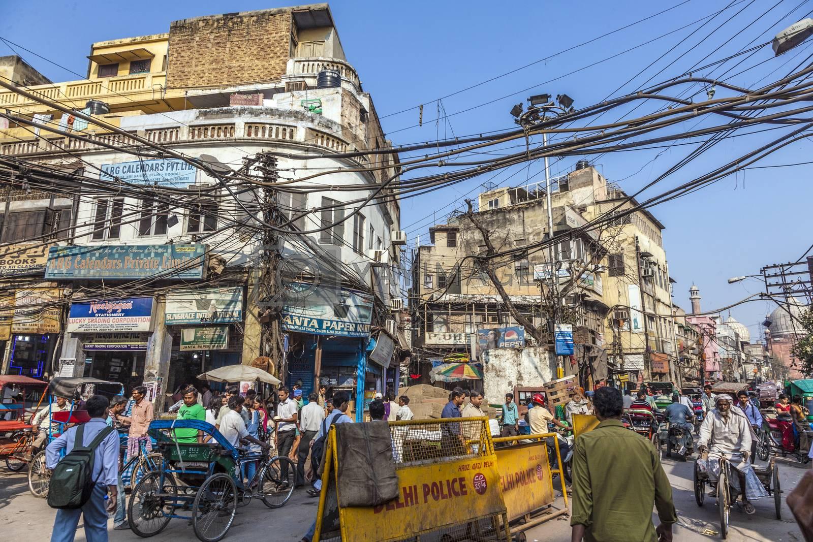 DELHI, INDIA - NOV 9, 2011: people in old Delhi in Chawri Bazaar, the famous old market in Delhi, India. Established in 1840, it was the first wholesale market of Old Delhi