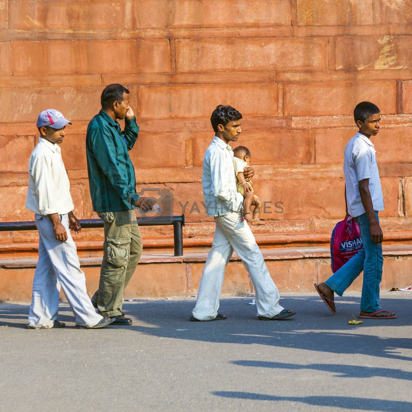 DELHI, INDIA - NOV 9, 2011: people visit the Red Fort in Delhi, India. Red Fort is a 17th century fort complex and was designated a UNESCO World Heritage Site in 2007.