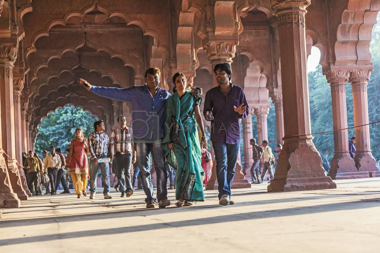 DELHI, INDIA - NOV 11, 2011: people visit the Red Fort in Delhi, India. Red Fort is a 17th century fort complex and was designated a UNESCO World Heritage Site in 2007.