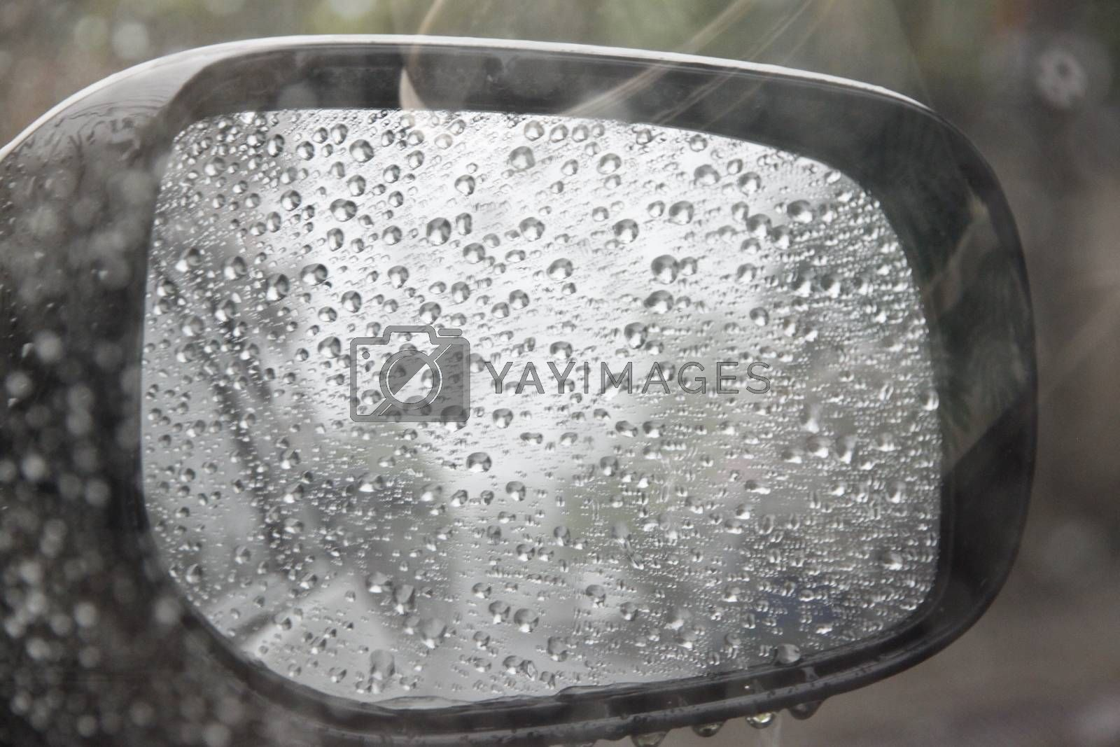 Dew on the mirrors,A rear view mirror on a rainy day.