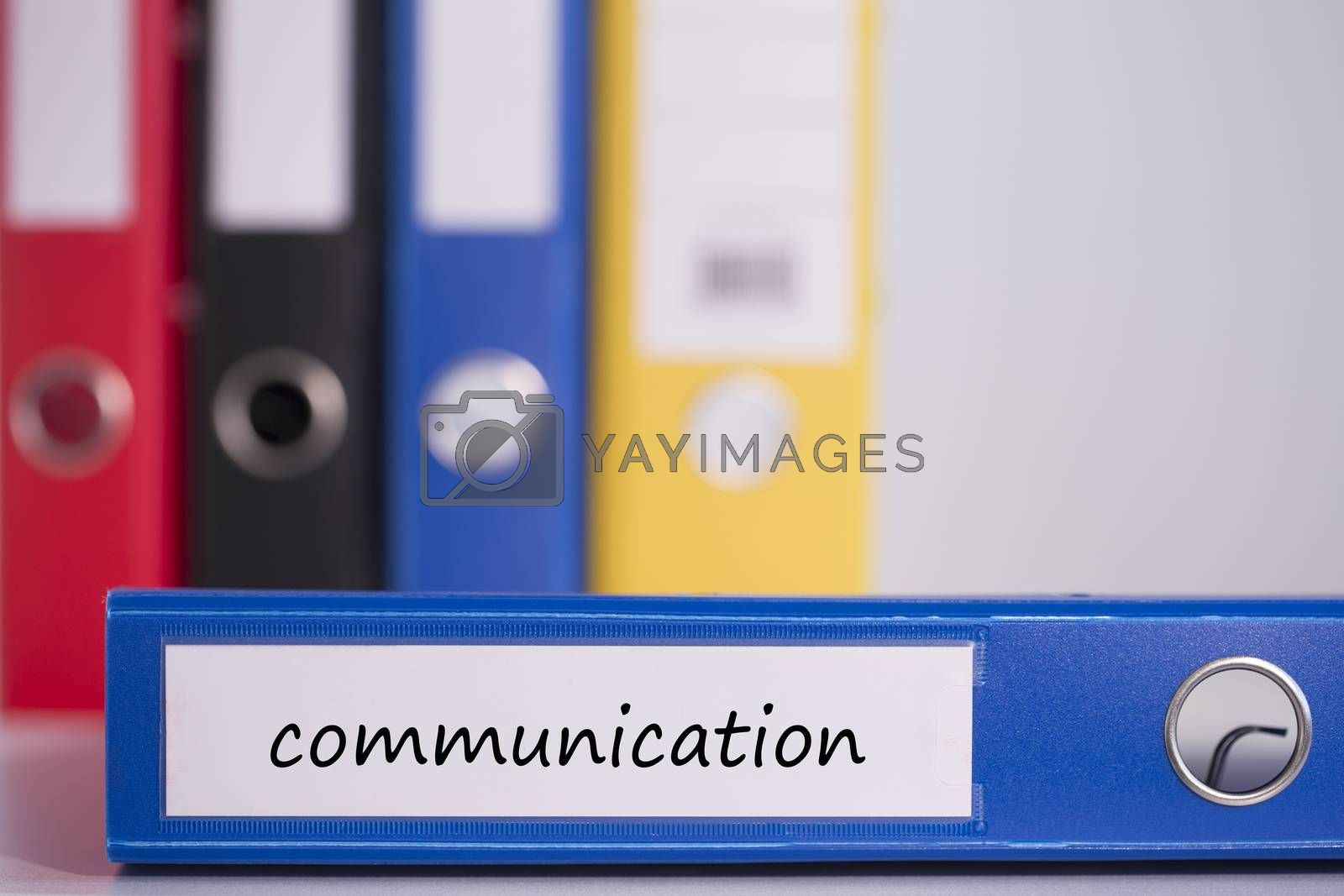 The word communication on blue business binder