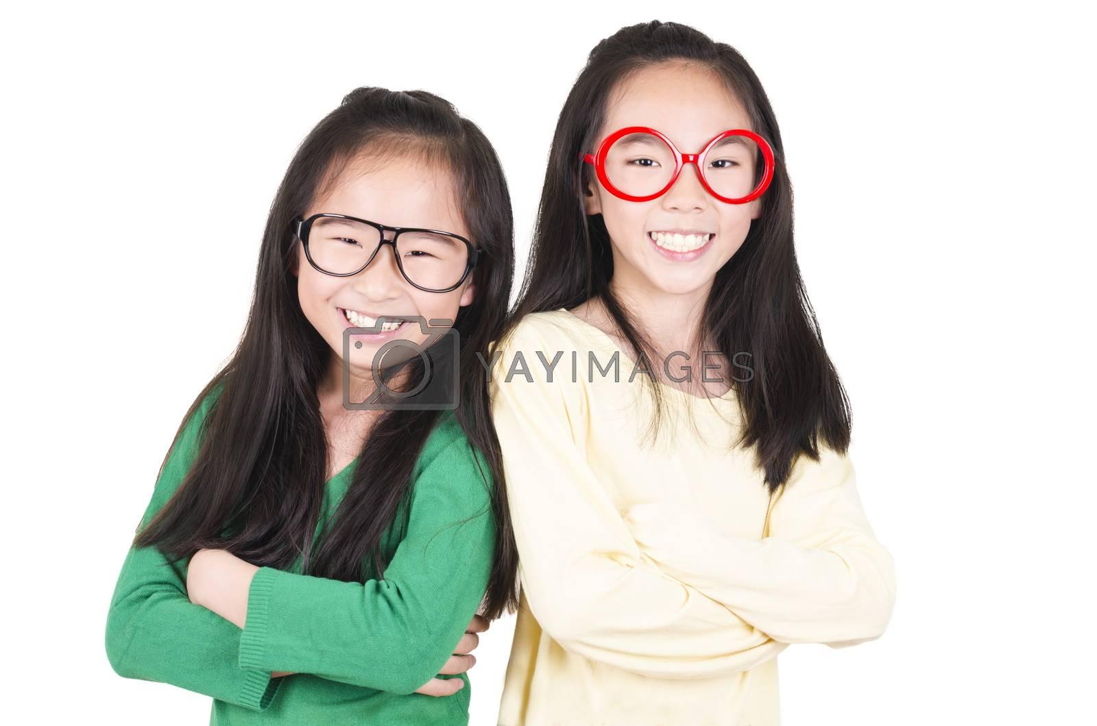 Royalty free image of Studio Portrait of Smiling Teenage Girls by FrankyLiu