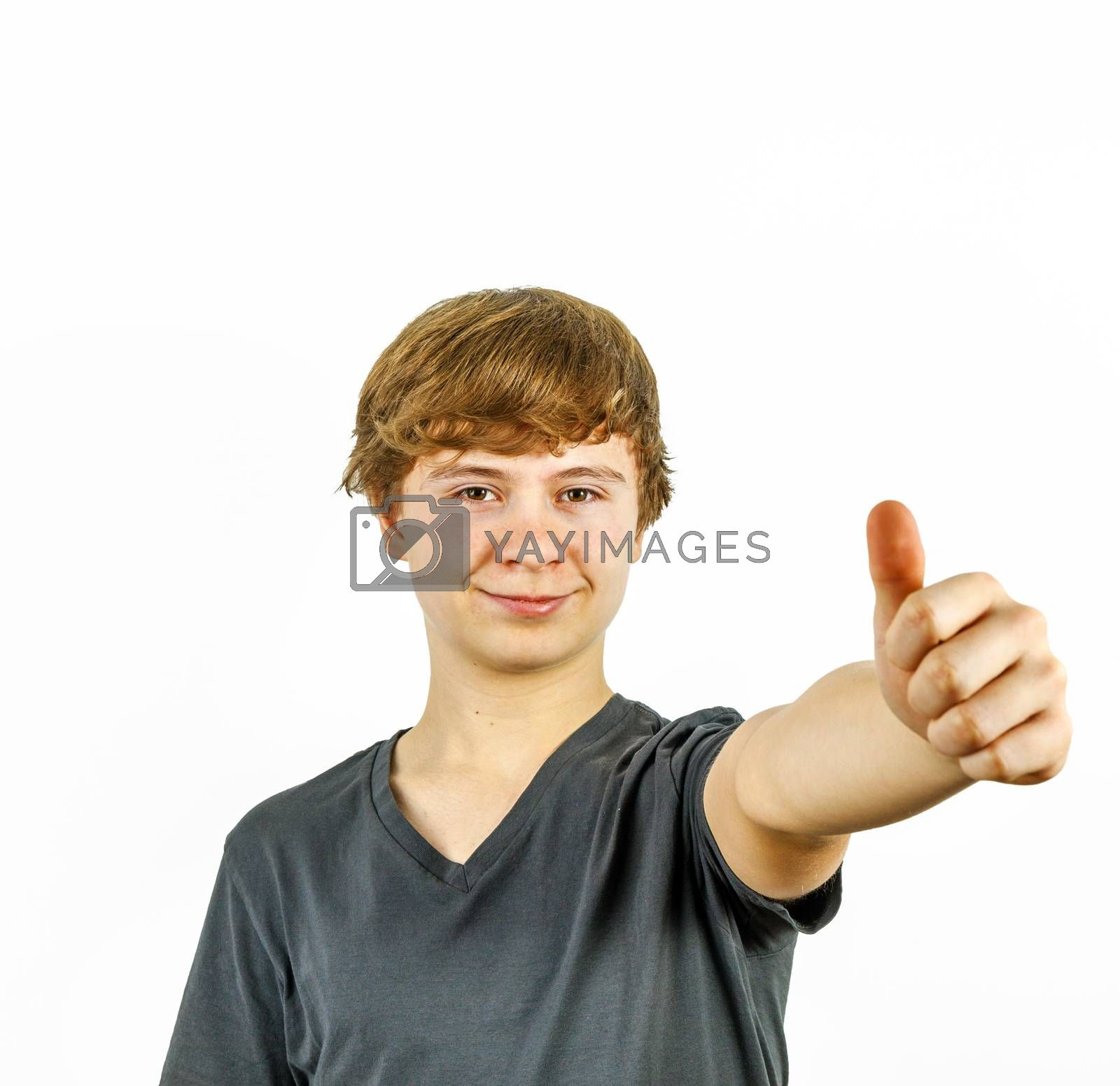 Teenage boy smiling showing thumbs up sign close up