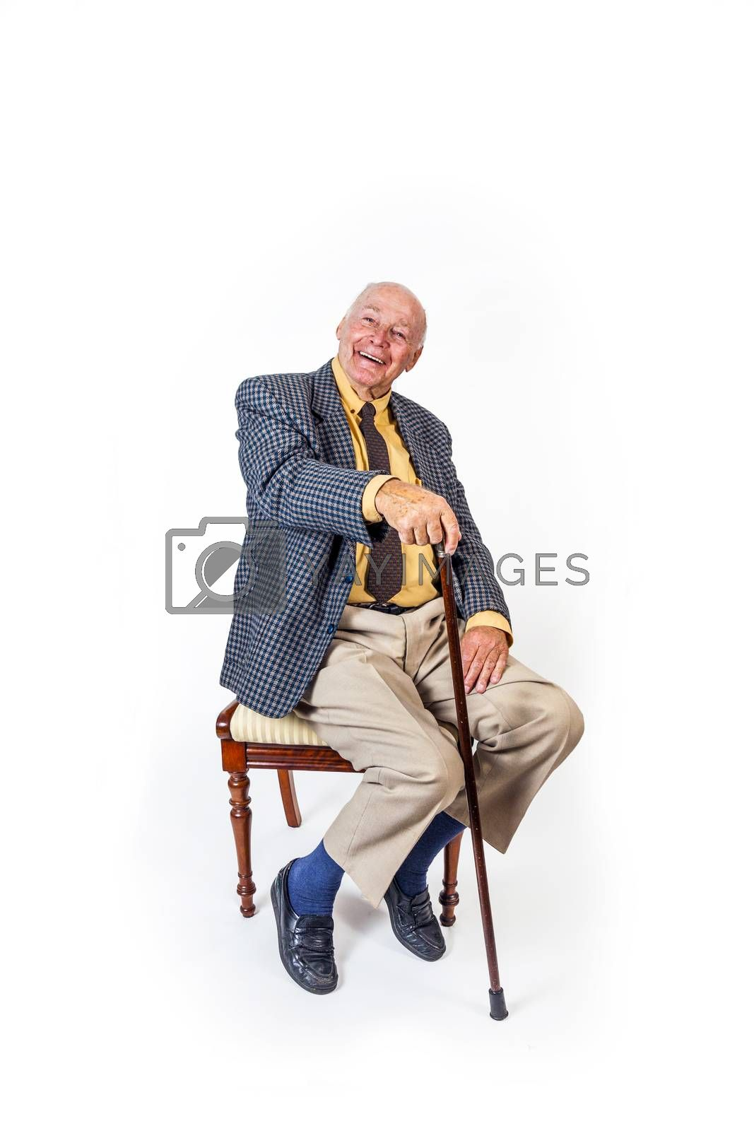 happy elderly man sitting in front of a white background