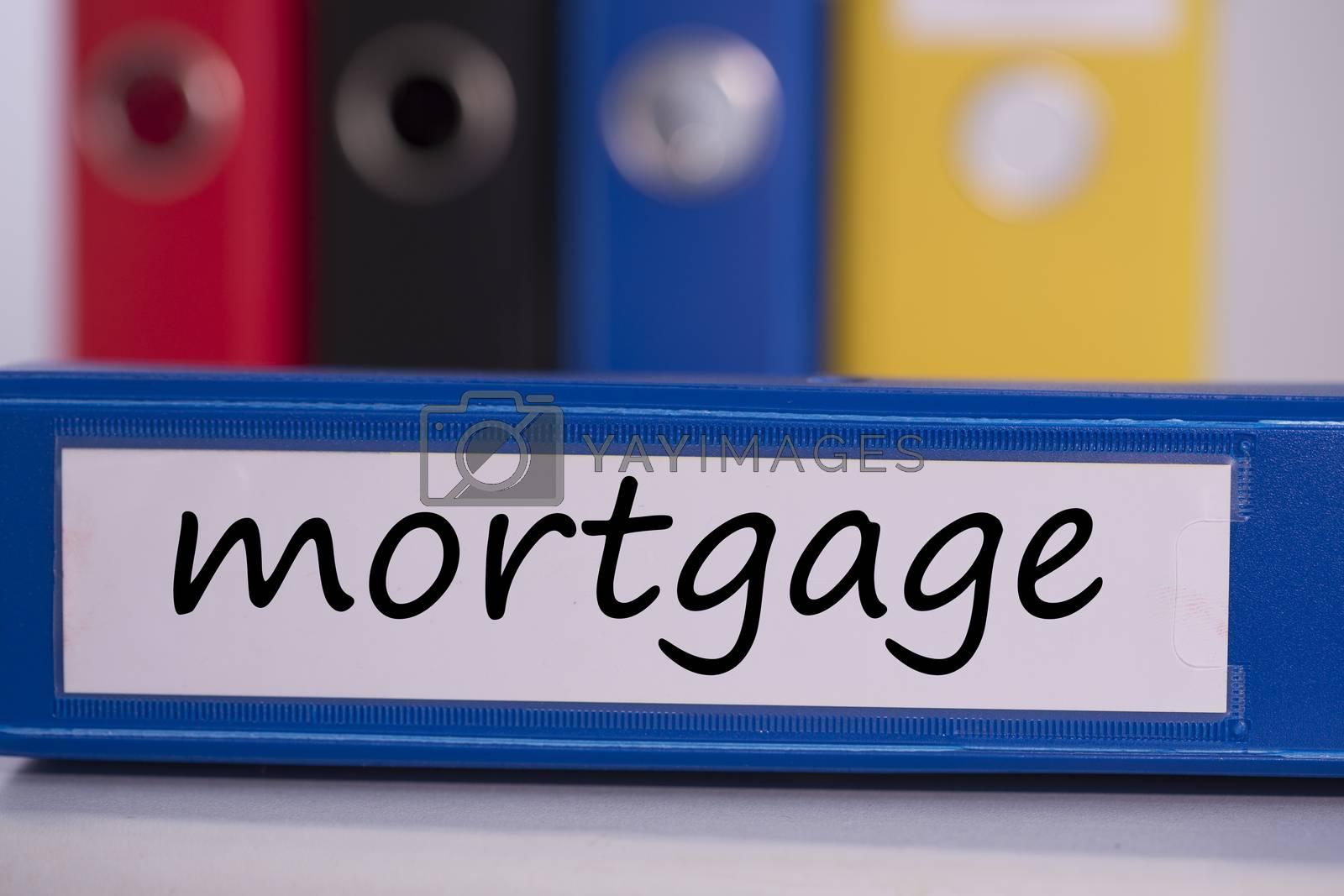 Mortgage on blue business binder by Wavebreakmedia