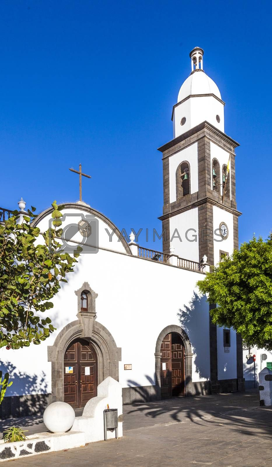 The beautiful church of San Gines in Arrecife with its white-washed exterior and attractive bell tower