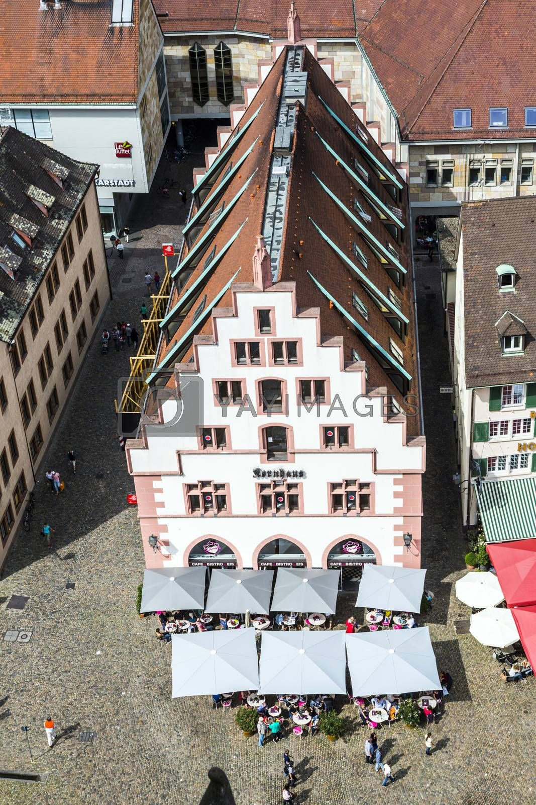 FREIBURG, GERMANY - JUNE 28: people at the old market place in Freiburg, Germany. The facade of the old Kornhaus dates back to  1498 .