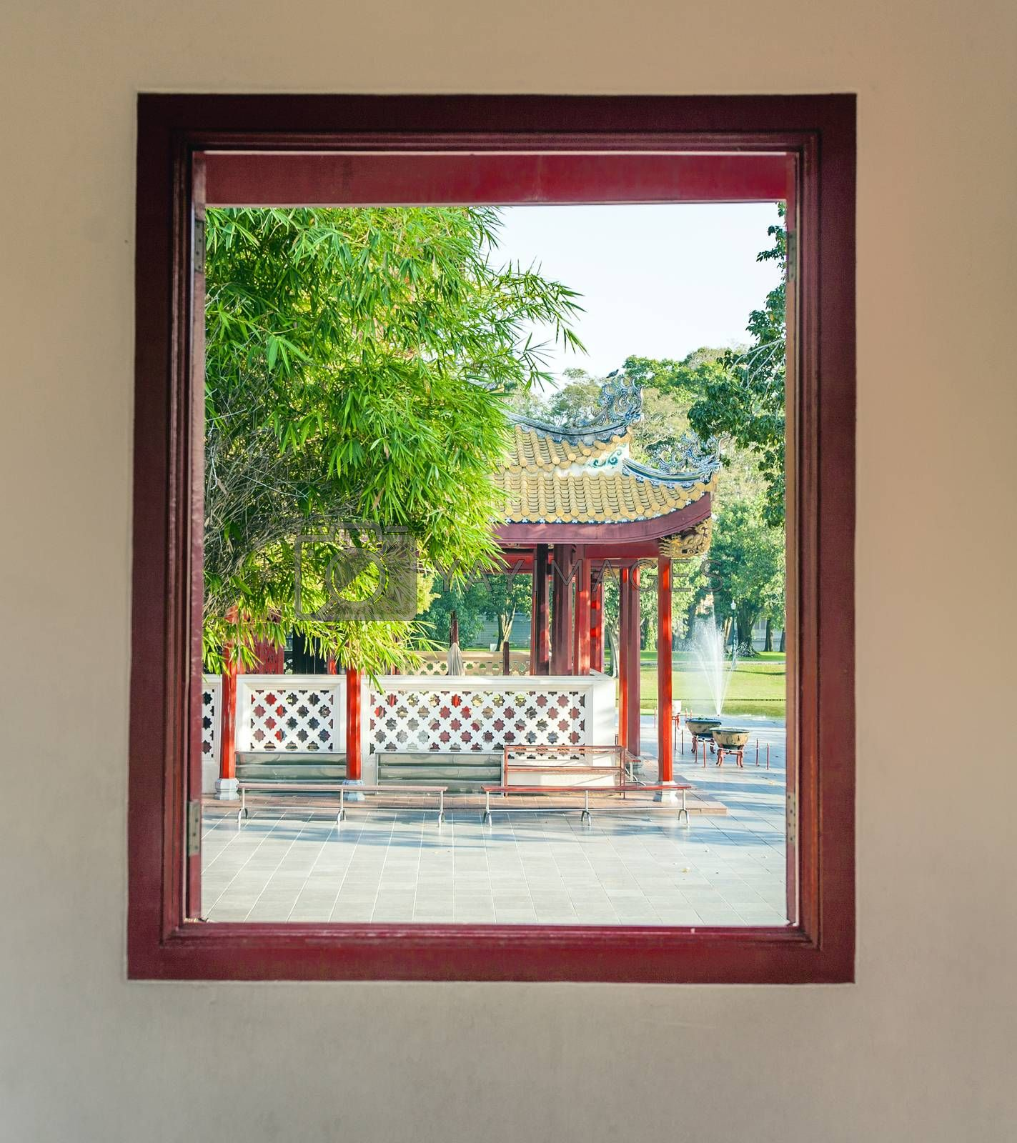 Royalty free image of view out of a window to the park in the Sommerpalace Bang Pa In  by meinzahn