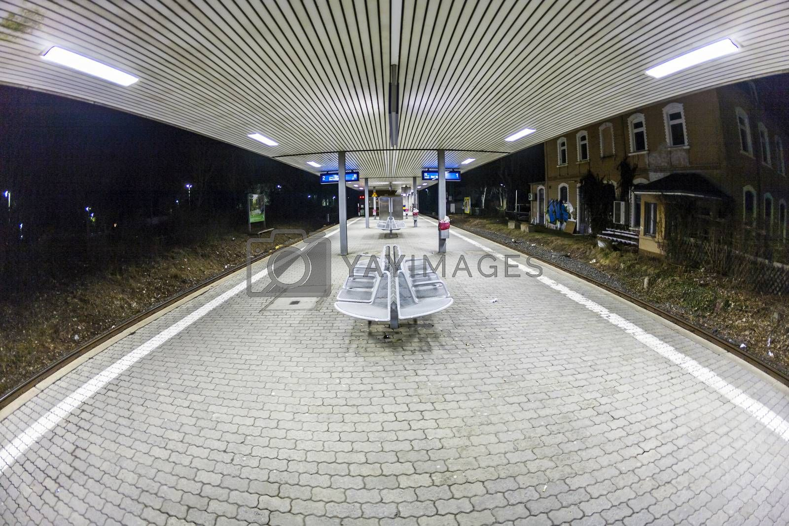 Royalty free image of empty station early morning in the dark by meinzahn