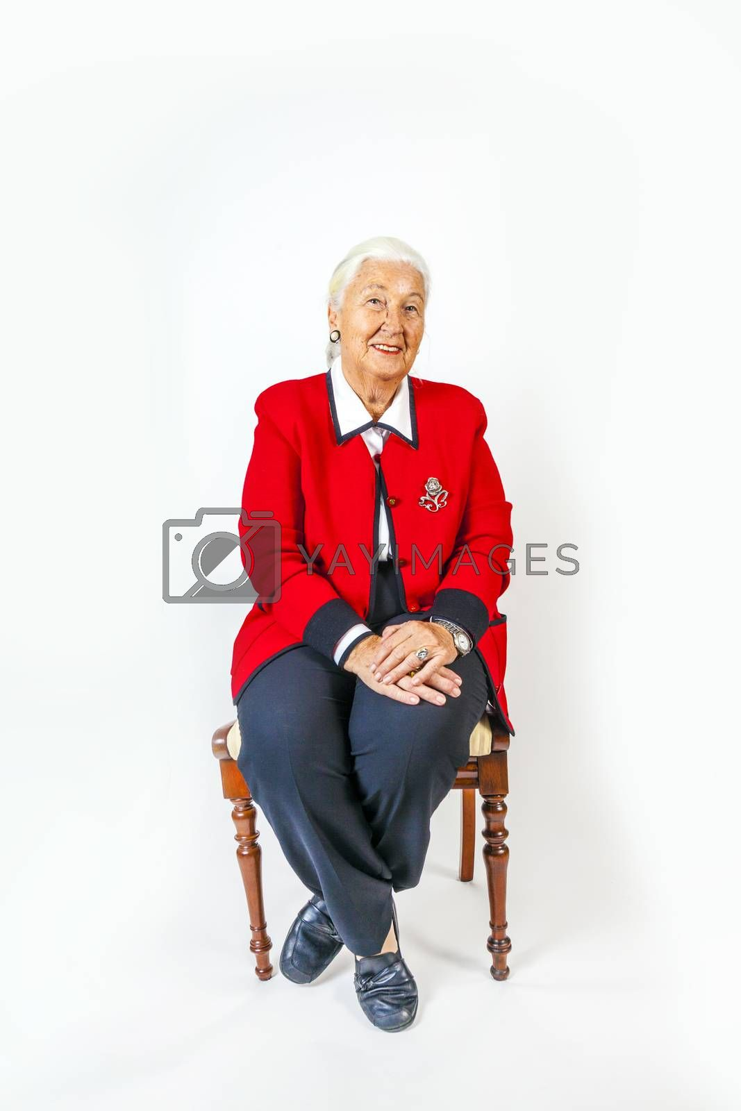 portrait of smiling attractive senior woman in front of a white background