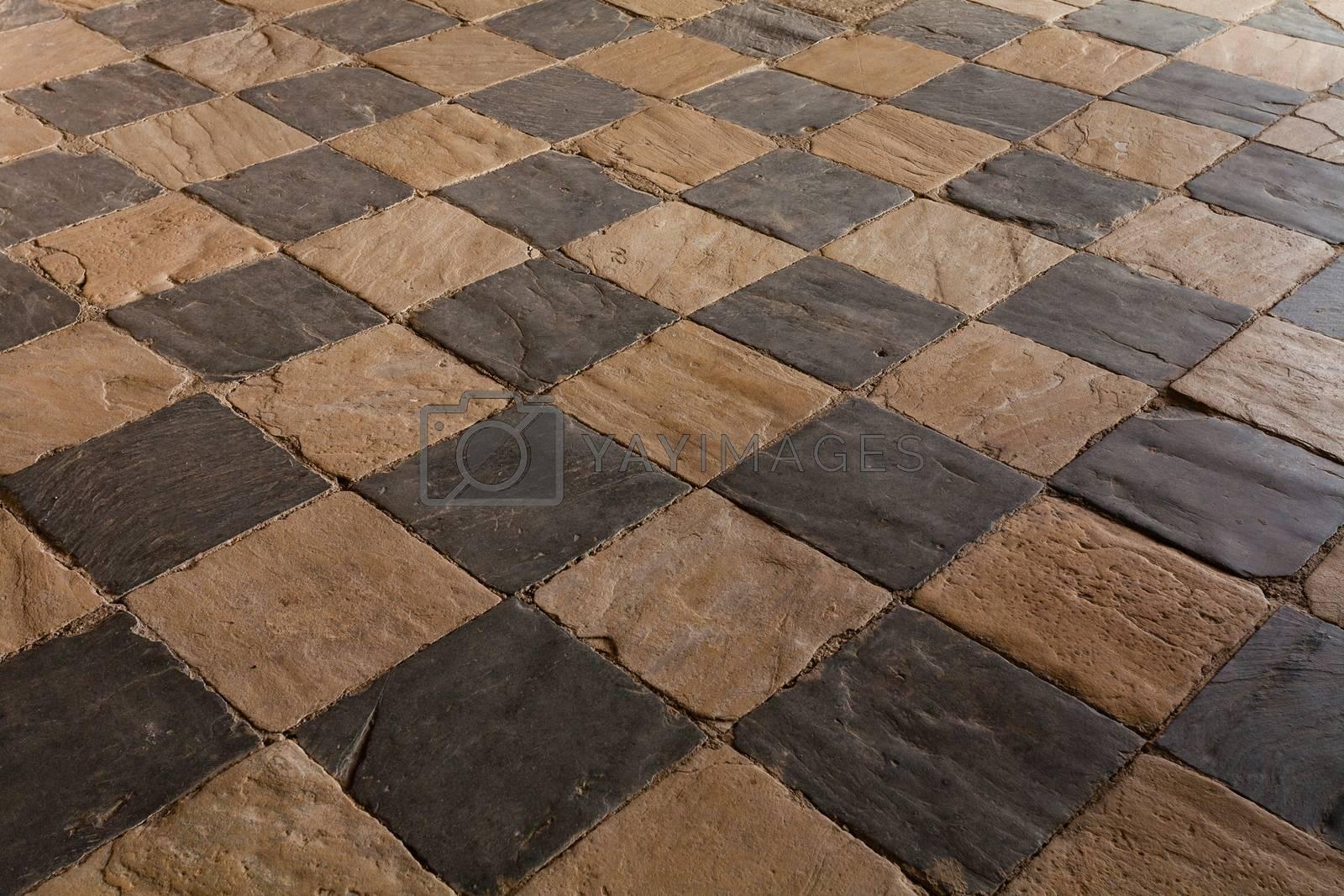 draughtboarded floor built in slate and limestone rocks in Spain