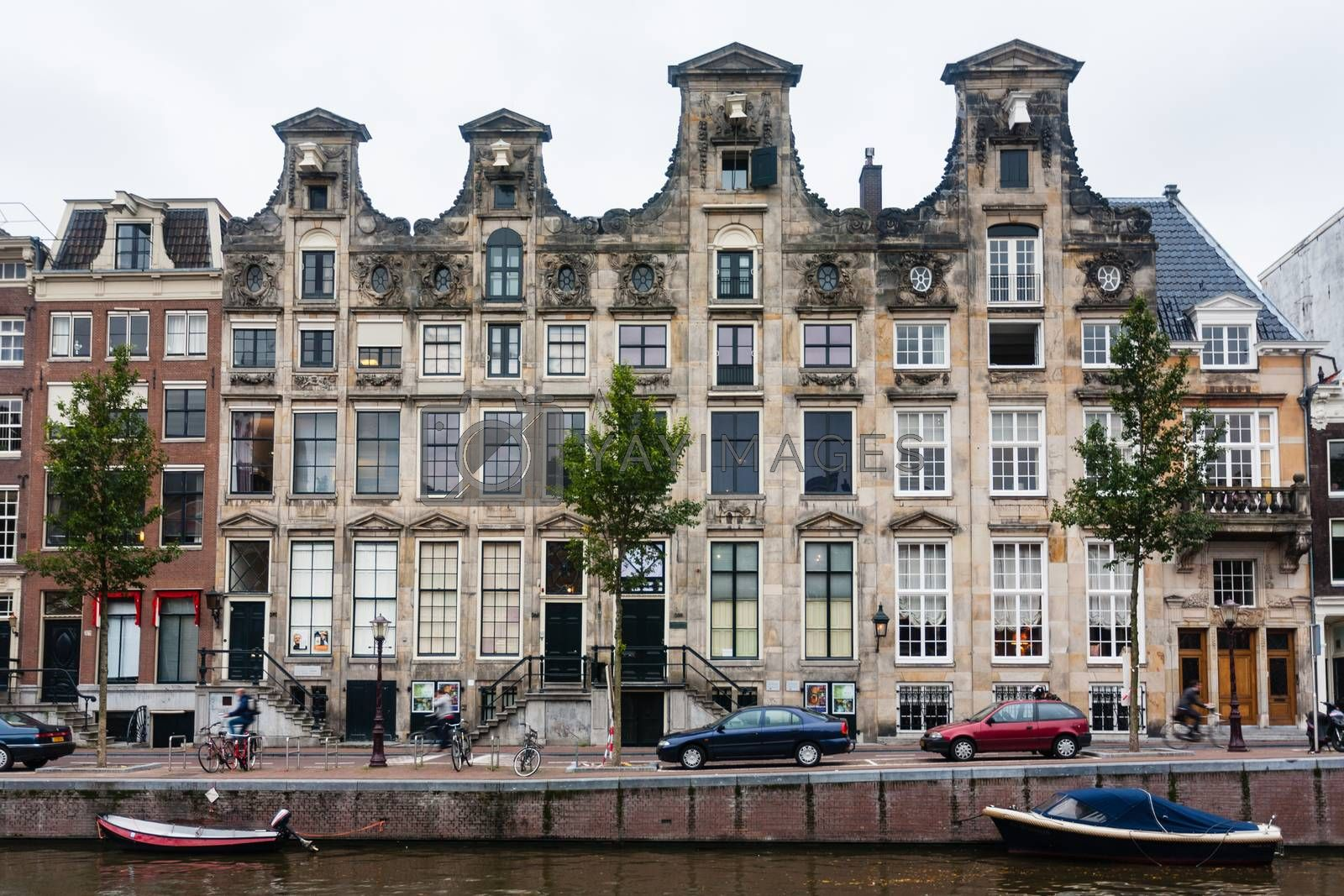 Ancien typical Amsterddam house next to de canal