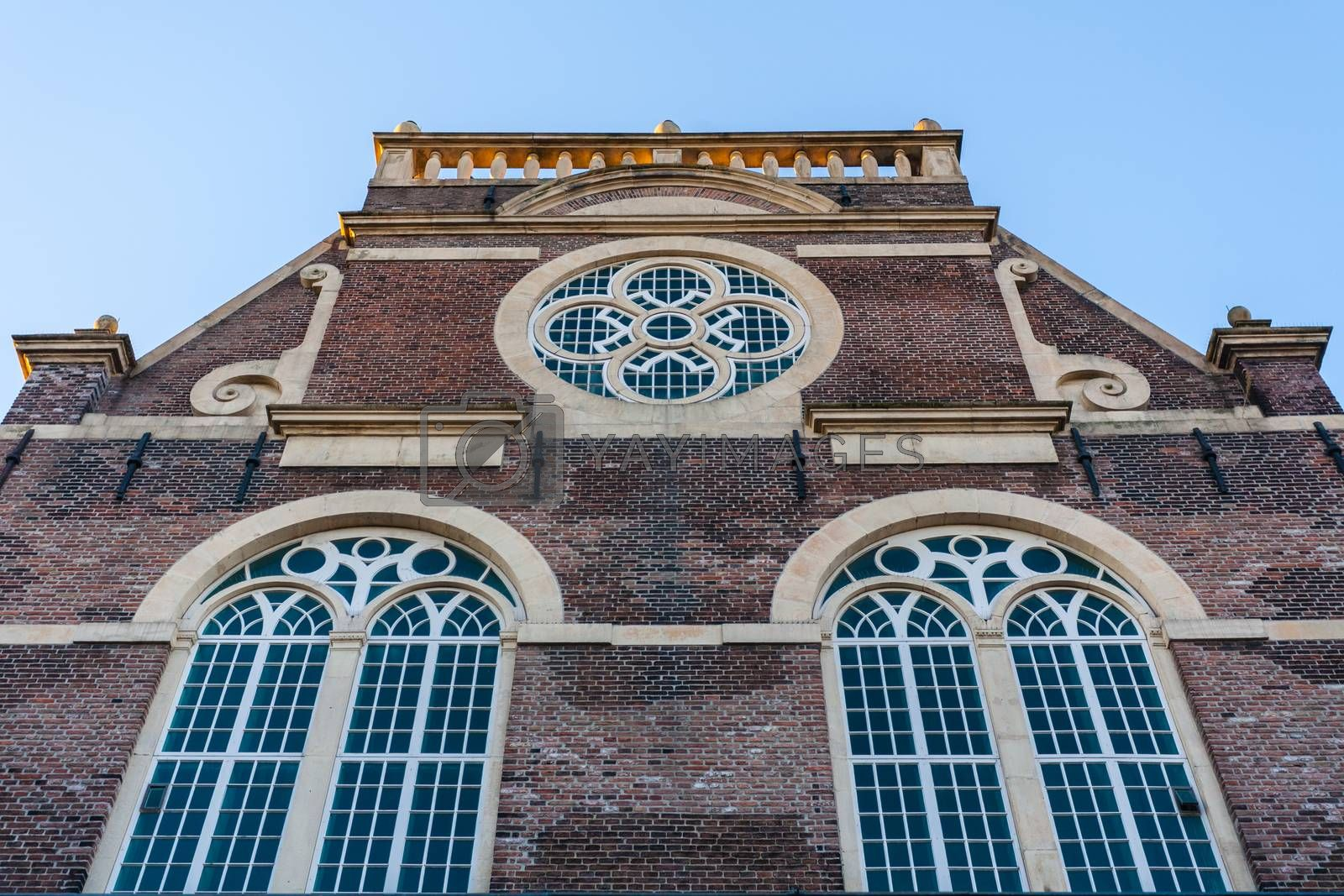 Church facade in Amsterdam with rose window