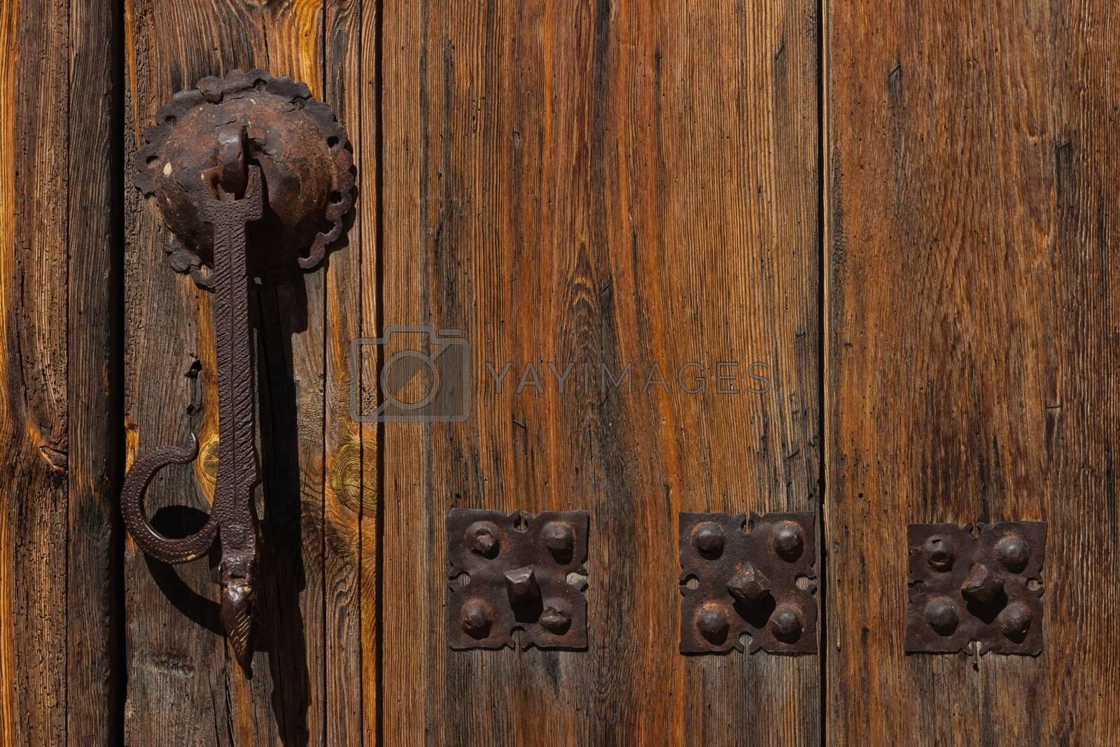 Door knocker in a house entrance door in the village of Moron de Almazan Province of Soria, Spain