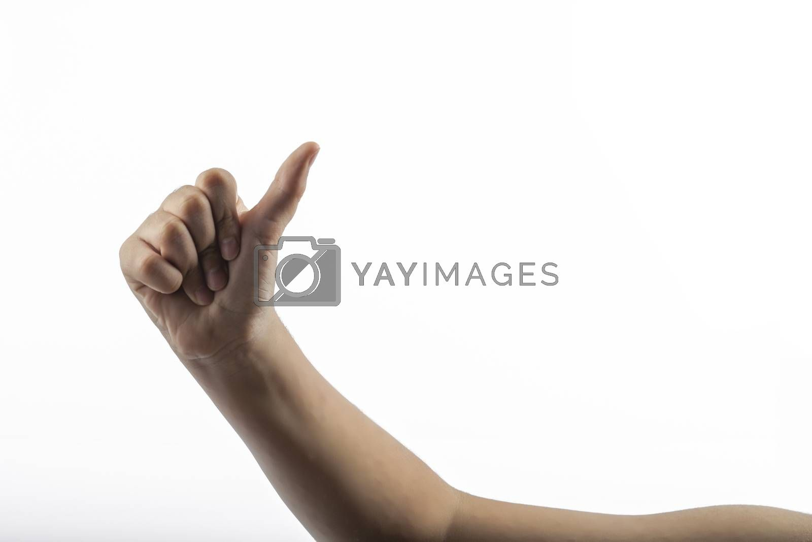Young hands makes a gesture: hitchhiking sign