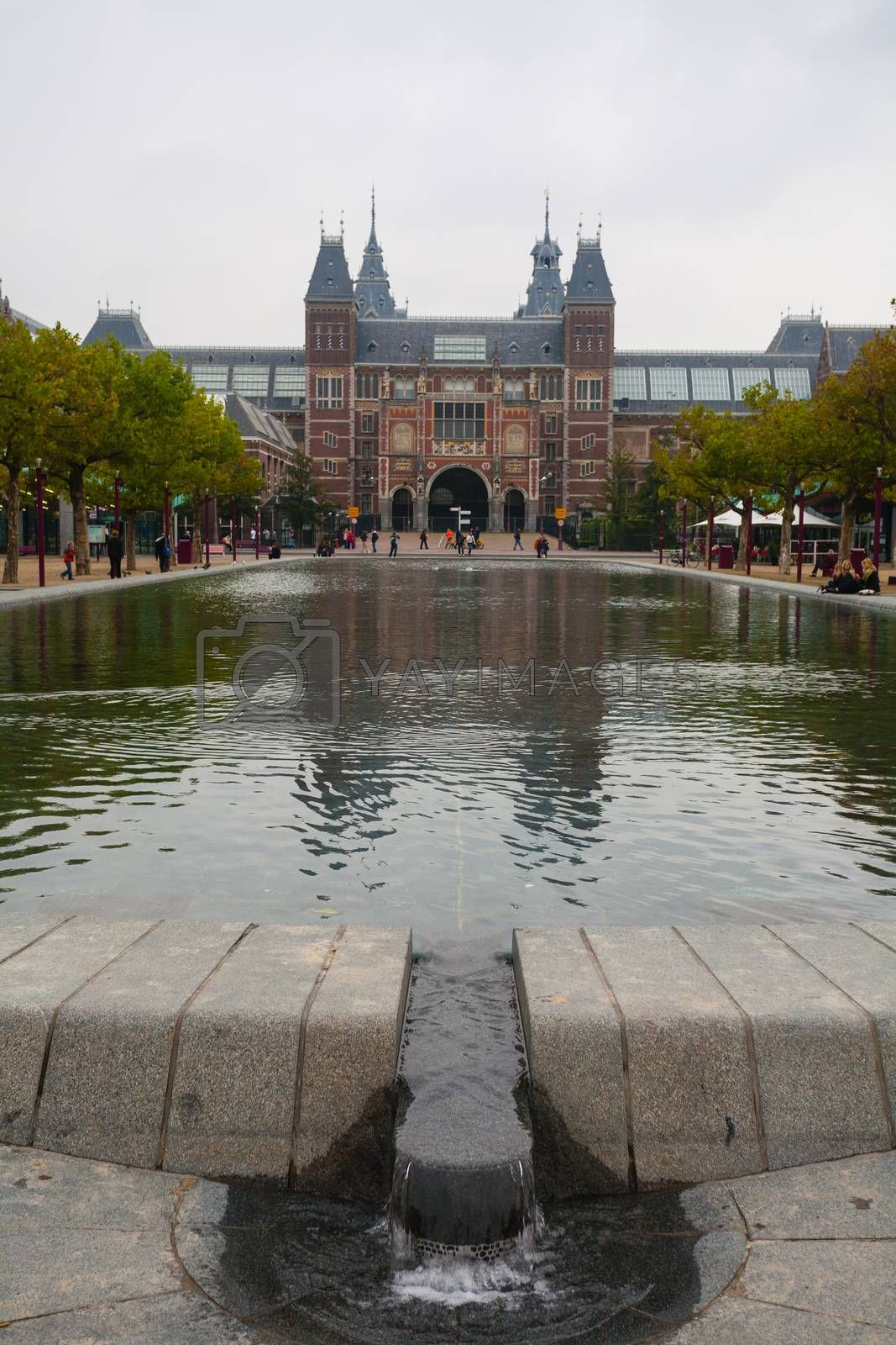 Rijksmuseum main facade from the park vertical view in Amsterdam Holland