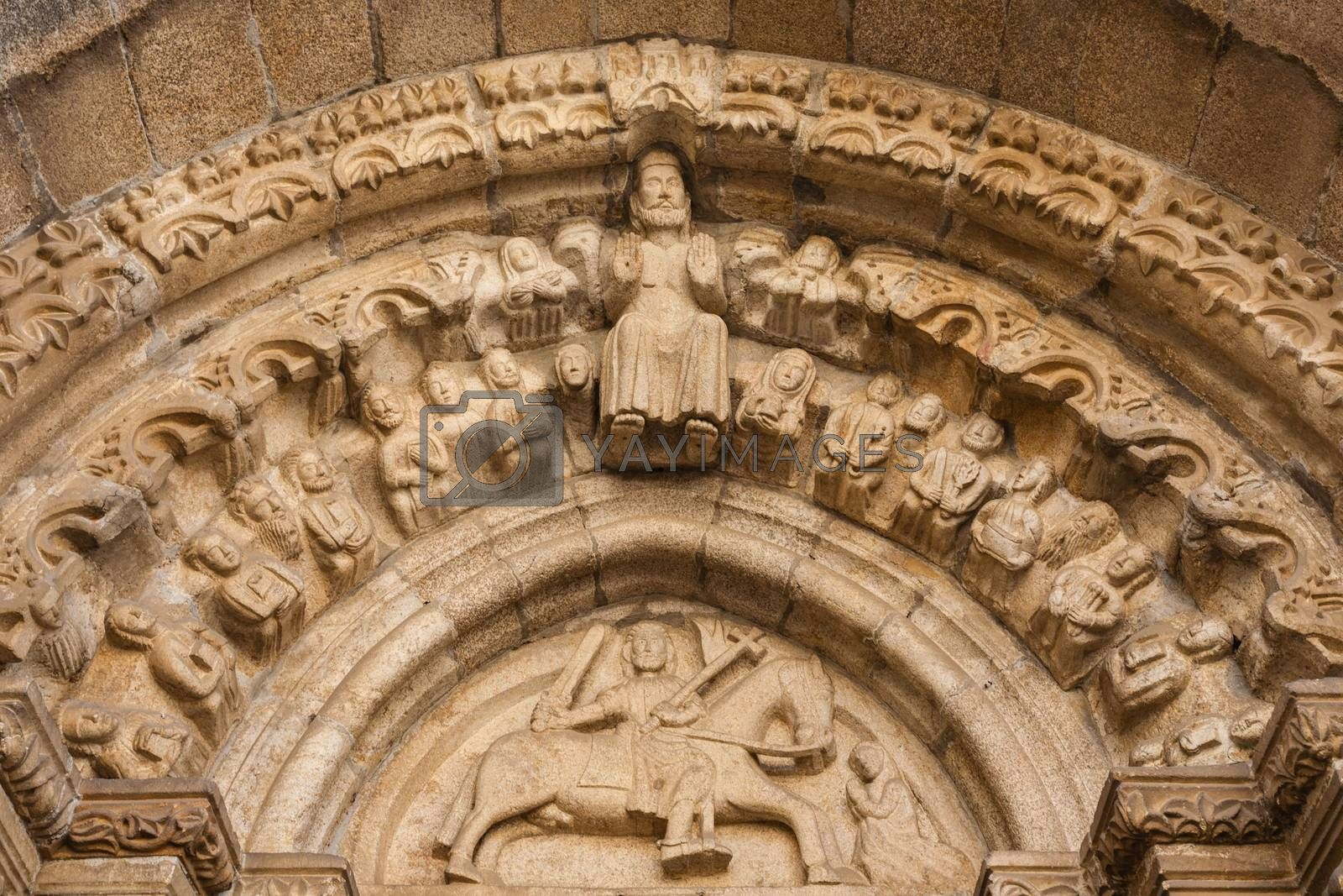 Detailed view of archivolts and tympanum in the  main entrance to Santiago church in Betanzos, La Coru��a, Spain