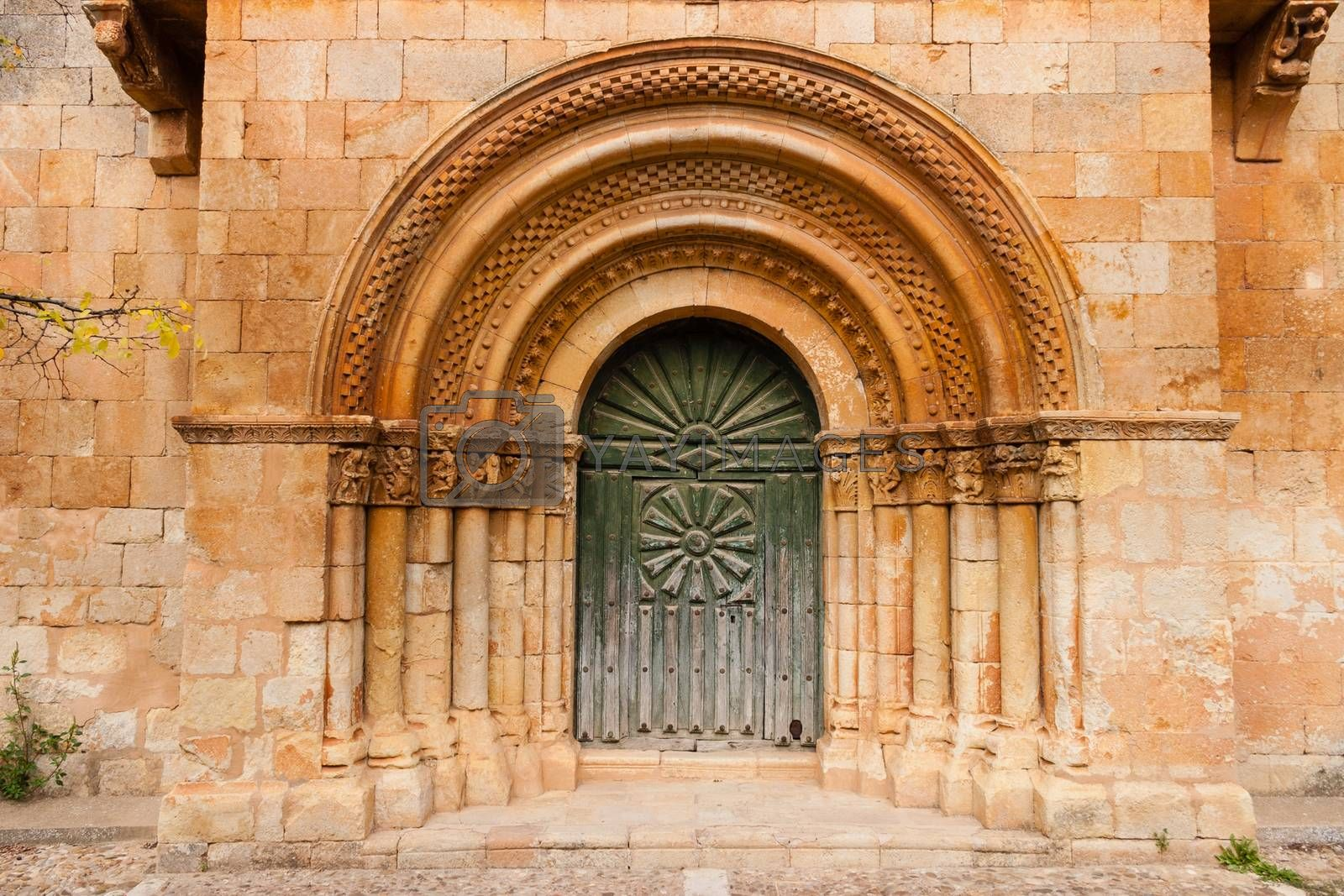 Romanesque portal with fine archivolts and beautiful door of the church in a small village called Moarves de Ojeda in the povince of Palencia  Spain