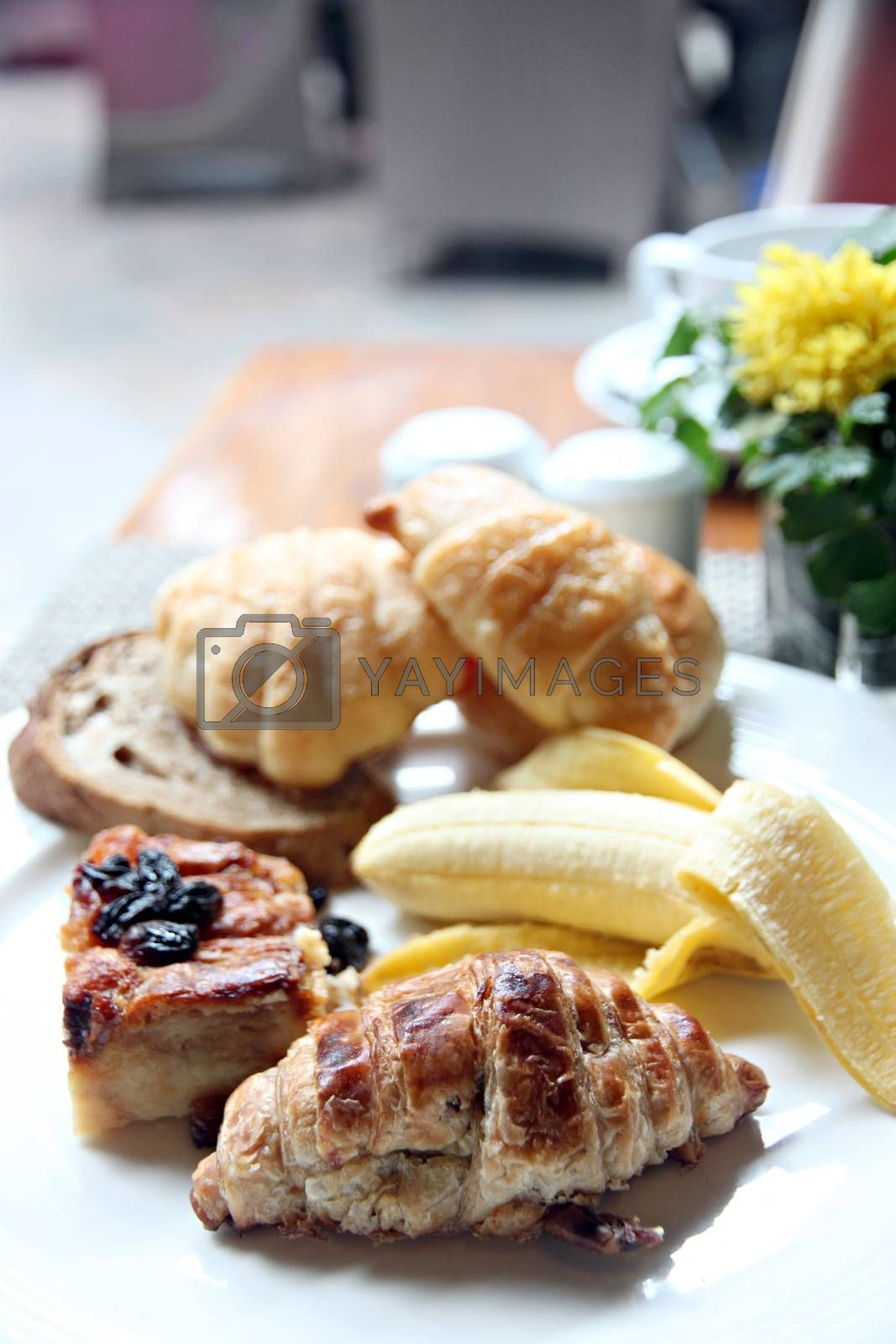 Banana bread sheet and toast in a white dish of breakfast.