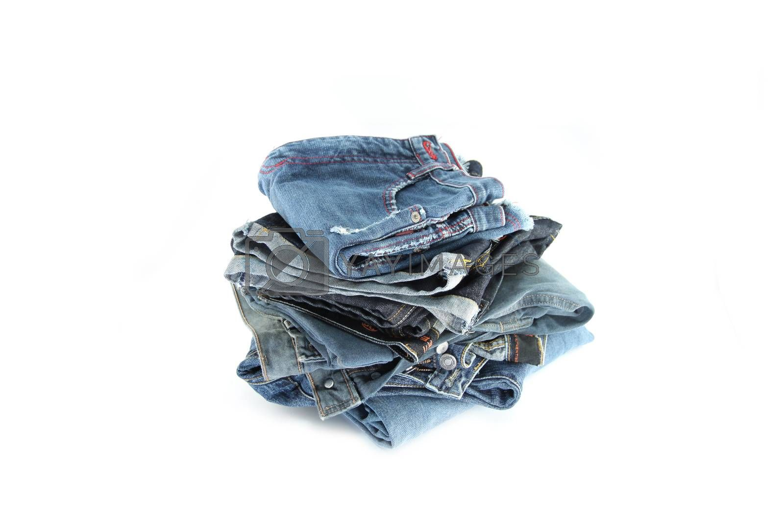 The blue Jeans Placing stacked on the white background.
