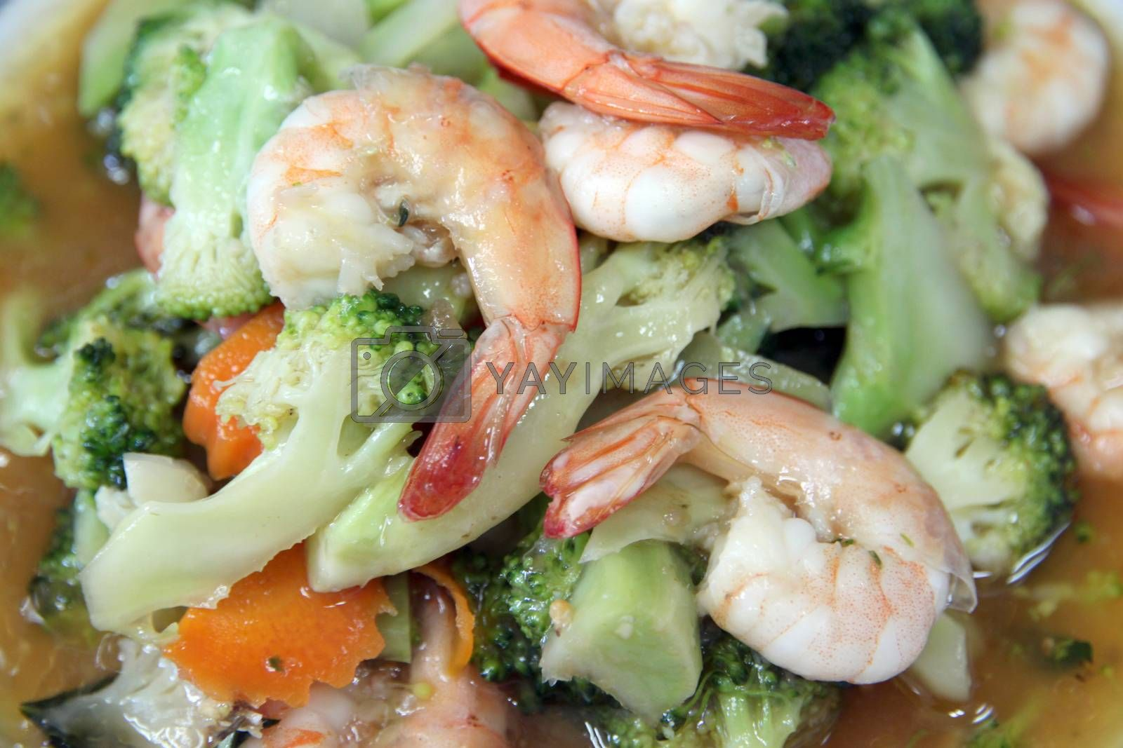 Shrimp fried vegetables in the dish.