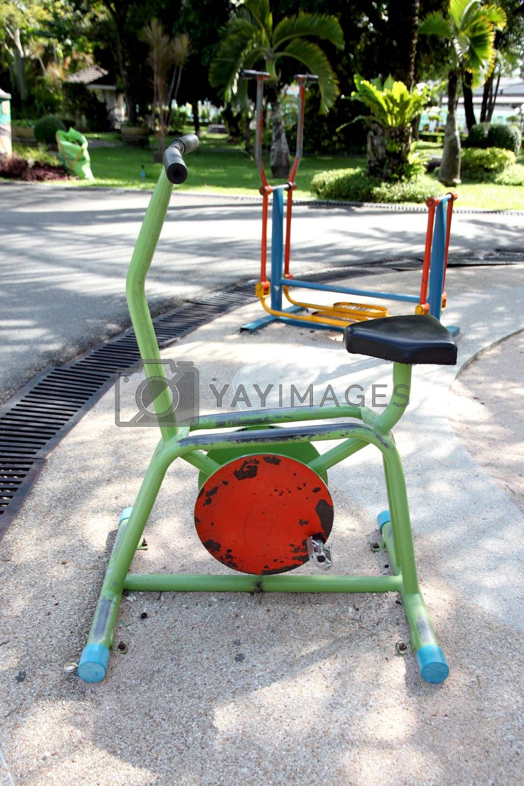 Exercise equipment in the park. by PiyaPhoto