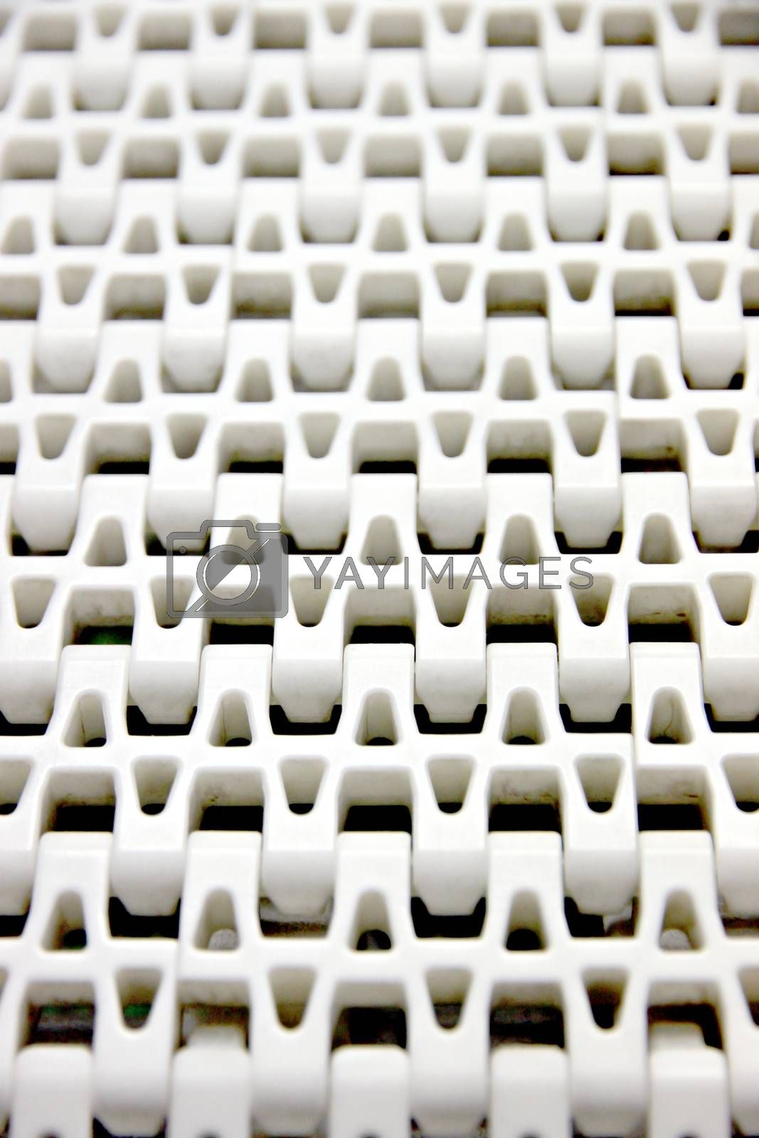 Patterns of white plastic with a conveyor belt. by PiyaPhoto