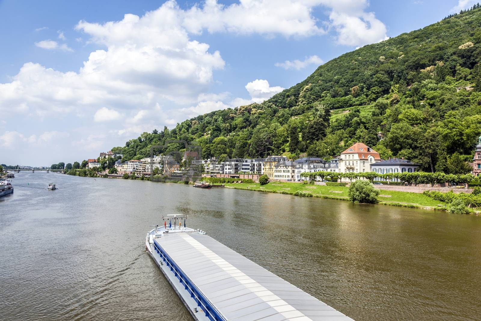 HEIDELBERG, GERMANY - JULY 6, 2013: freight ship Aristo at the river Neckar  in Heidelberg, Germany. Freight ships on scenic Neckar River transport goods since centuries.