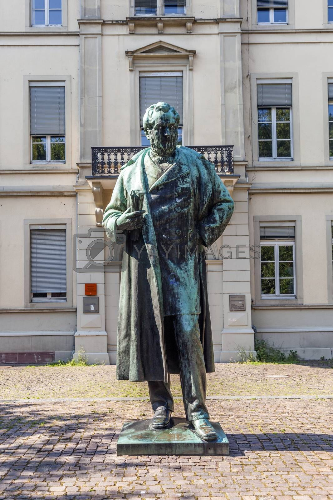 HEIDELBERG, GERMANY - JULY 7, 2013: statue of Robert Wilhelm Bunsen in Heidelberg, Germany. In 1852 Bunsen became professor for chemics at the  Ruprecht-Karl university in Heidelberg.