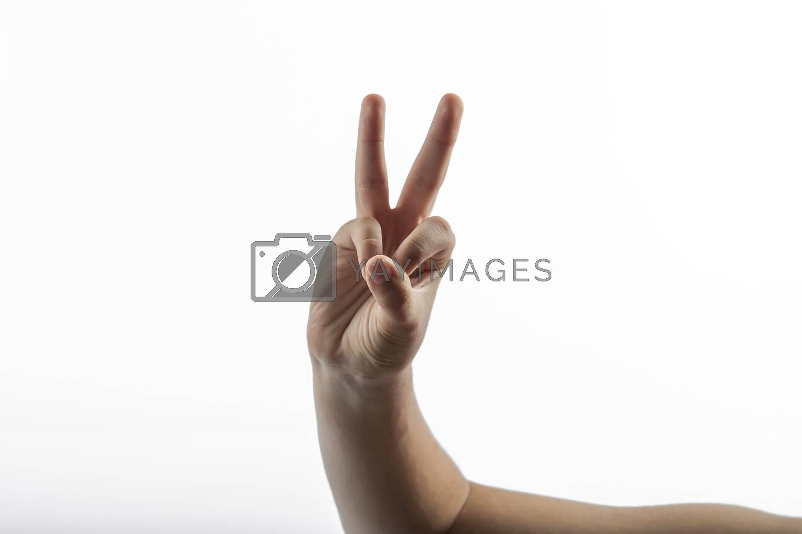 Young hands make a 2 fingers gesture
