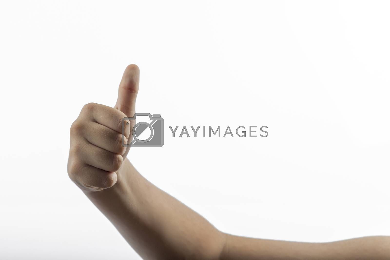 Young hands make a hitchhiking gesture