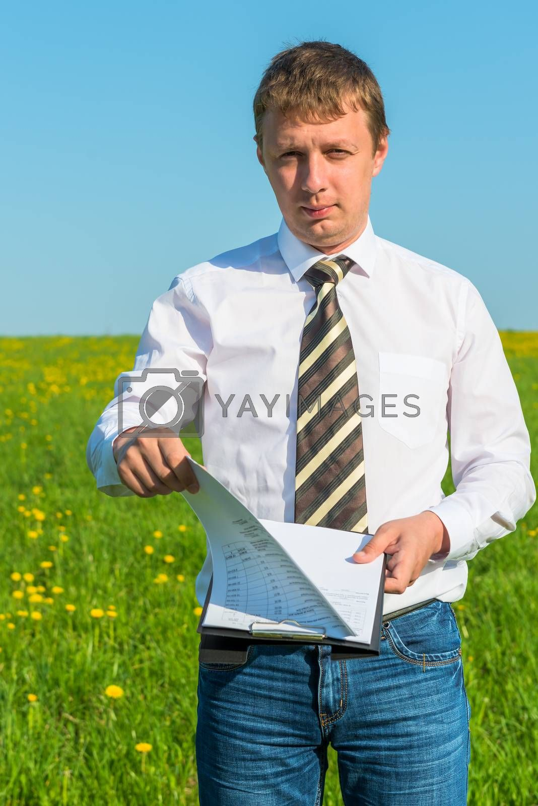 businessman studies the financial statements on the nature