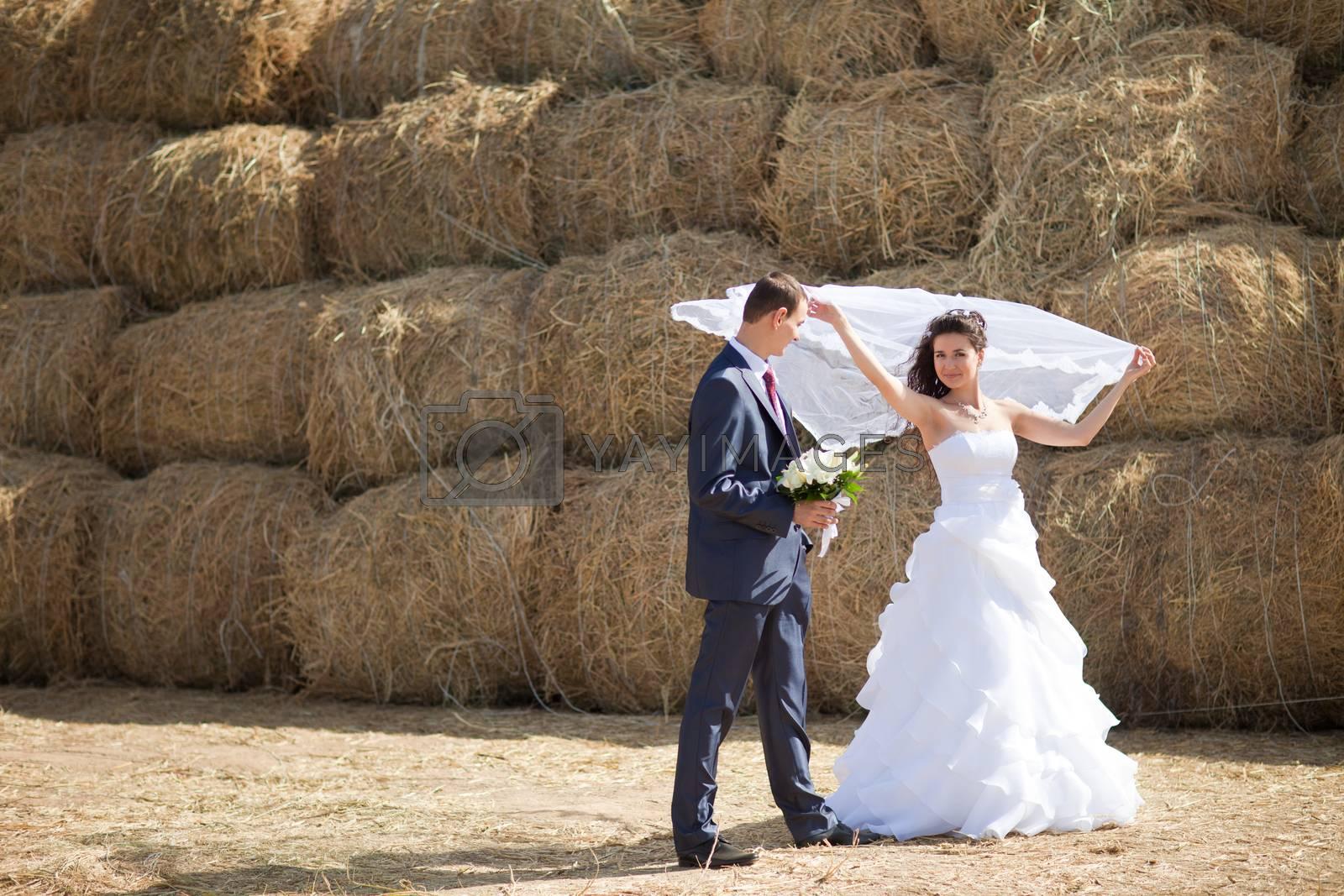 couple near the hay